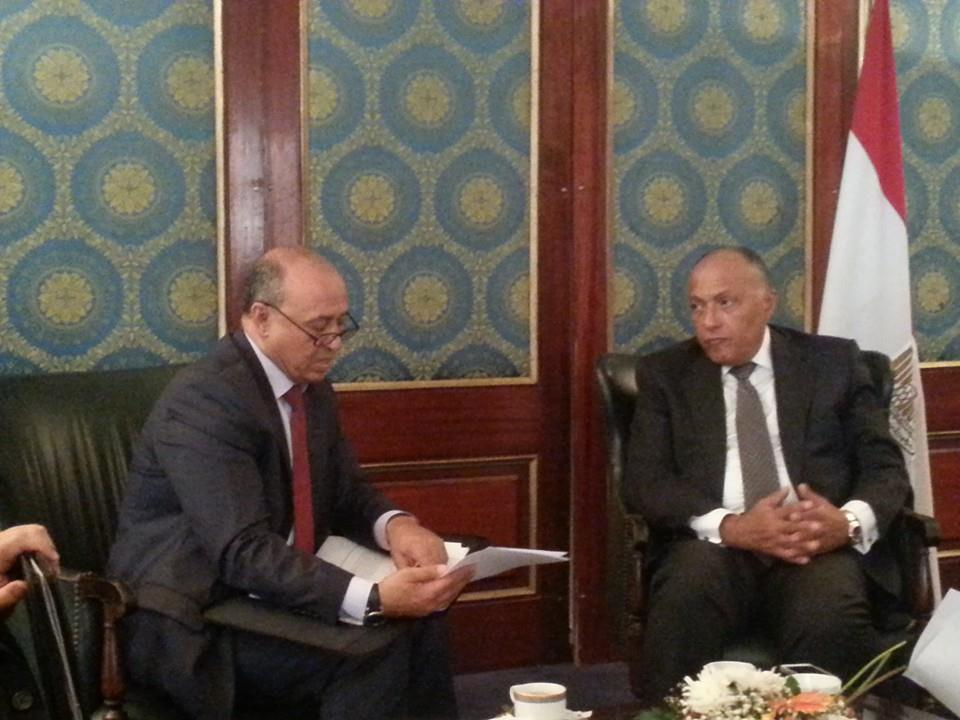 Egyptian Minister of Foreign Affairs Sameh Shoukry (right) meets with his Libyan counterpart Mohamed Abdel-Aziz (left) in Cairo (Photo Handout from the Egyptian Ministry of Foreign Affairs)