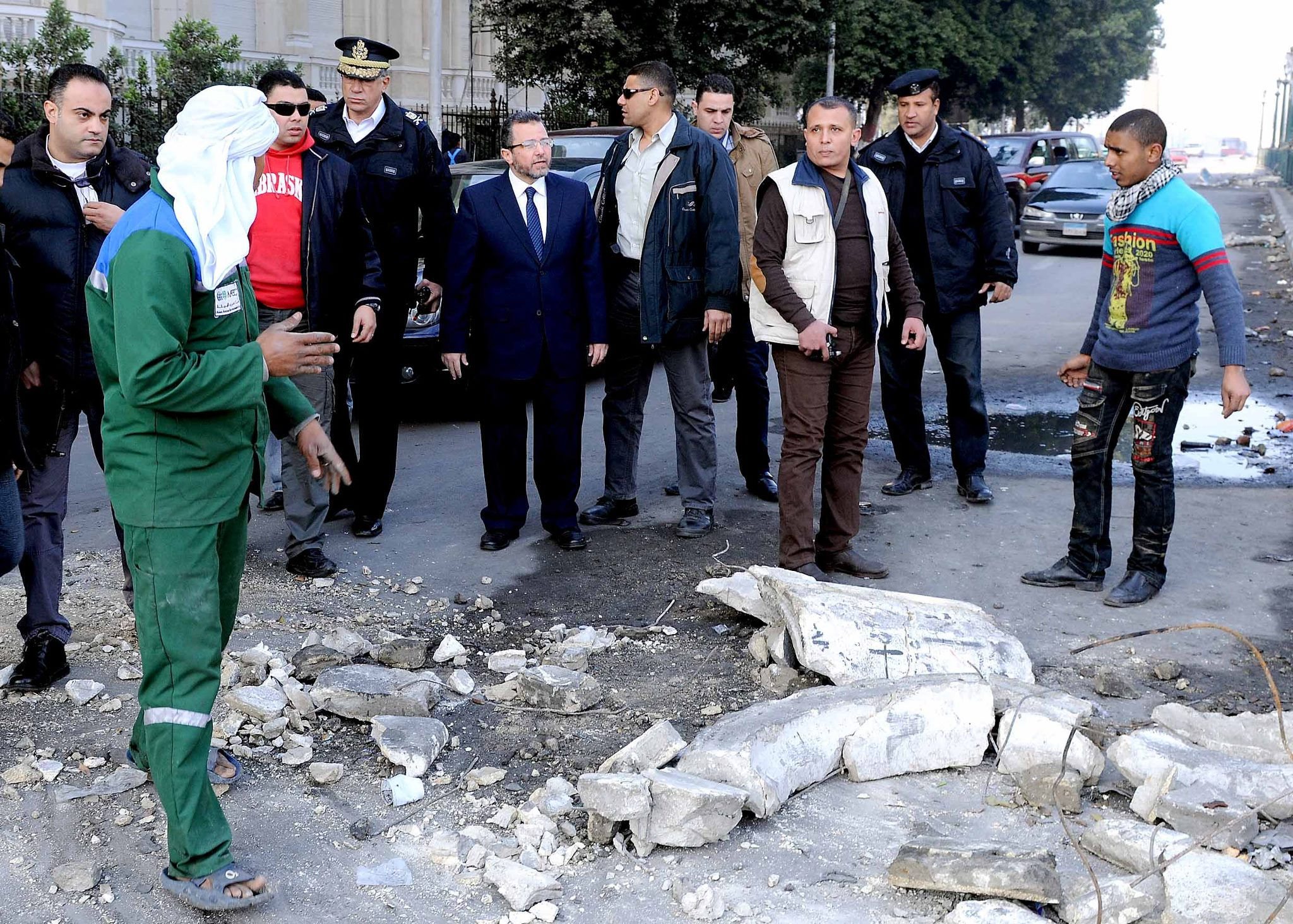 Prime Minister Hisham Qandil inspects the damage in the aftermath of the Presidential Palace (Photo courtesy of Hisham Qandil's Facebook page)