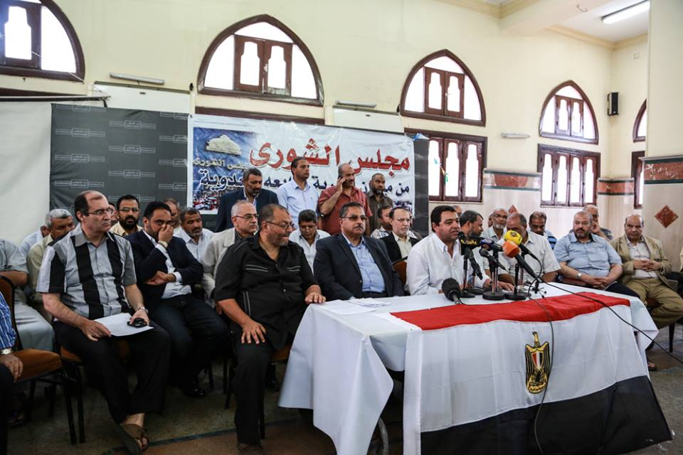 Members of the now dissolved Shura Council hold a council session within the pro-Morsi sit-in at Rabaa Al-Adaweya (Photo from The Freedom and Justice Party's Facebook page)