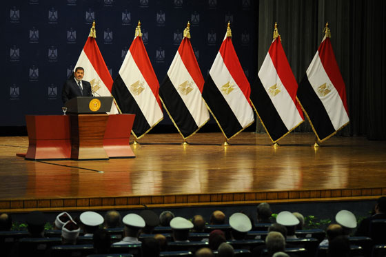 "In this hand out picture released by the Egyptian Presidency Egyptian President Mohammed Morsi addresses a conference to mark the upcoming anniversary of one year in power on June 26, 2013 in Cairo, Egypt. Islamist President Mohamed Morsi warned on Wednesday that political divisions in Egypt ""threaten to paralyse"" the country, as at least one person was killed and scores were hurt in clashes between his supporters and opponents. == RESTRICTED TO EDITORIAL USE - MANDATORY CREDIT ""AFP PHOTO / HO / EGYPTIAN PRESIDENCY'"