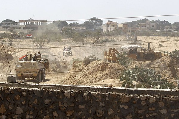 A picture taken from the Southern Gaza Strip shows Egyptian soldiers using bulldozers in search of tunnels on the border with Egypt and the Gaza Strip on September 8, 2013.  (AFP FILE PHOTO)
