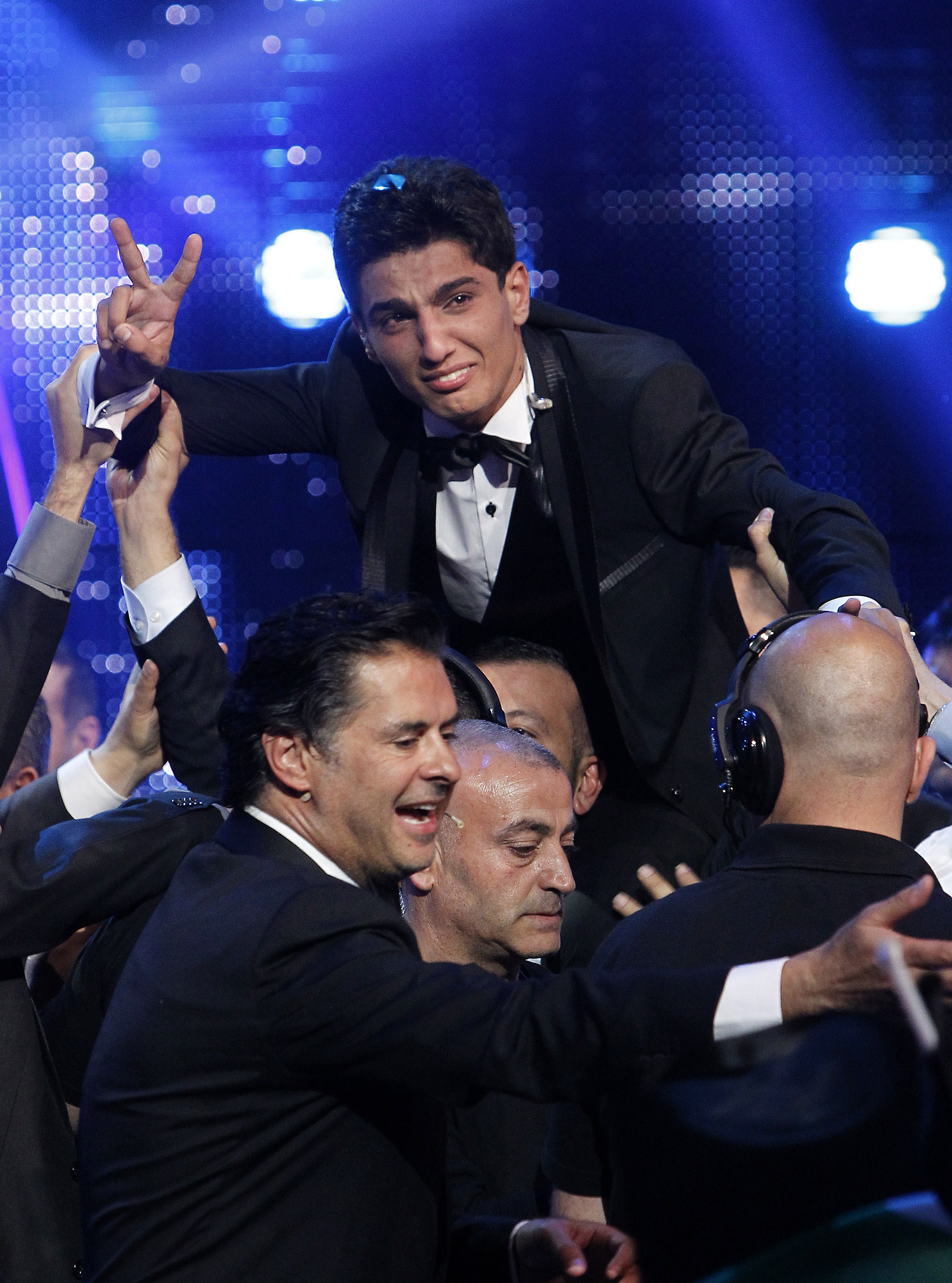 "Palestinian singer Mohammed Assaf cries of joy as he celebrates after winning the ""Arab Idol"" singing contest in Zouk Mosbeh, north of the Lebanese capital Beirut, early on June 23, 2013 (AFP Photo)"