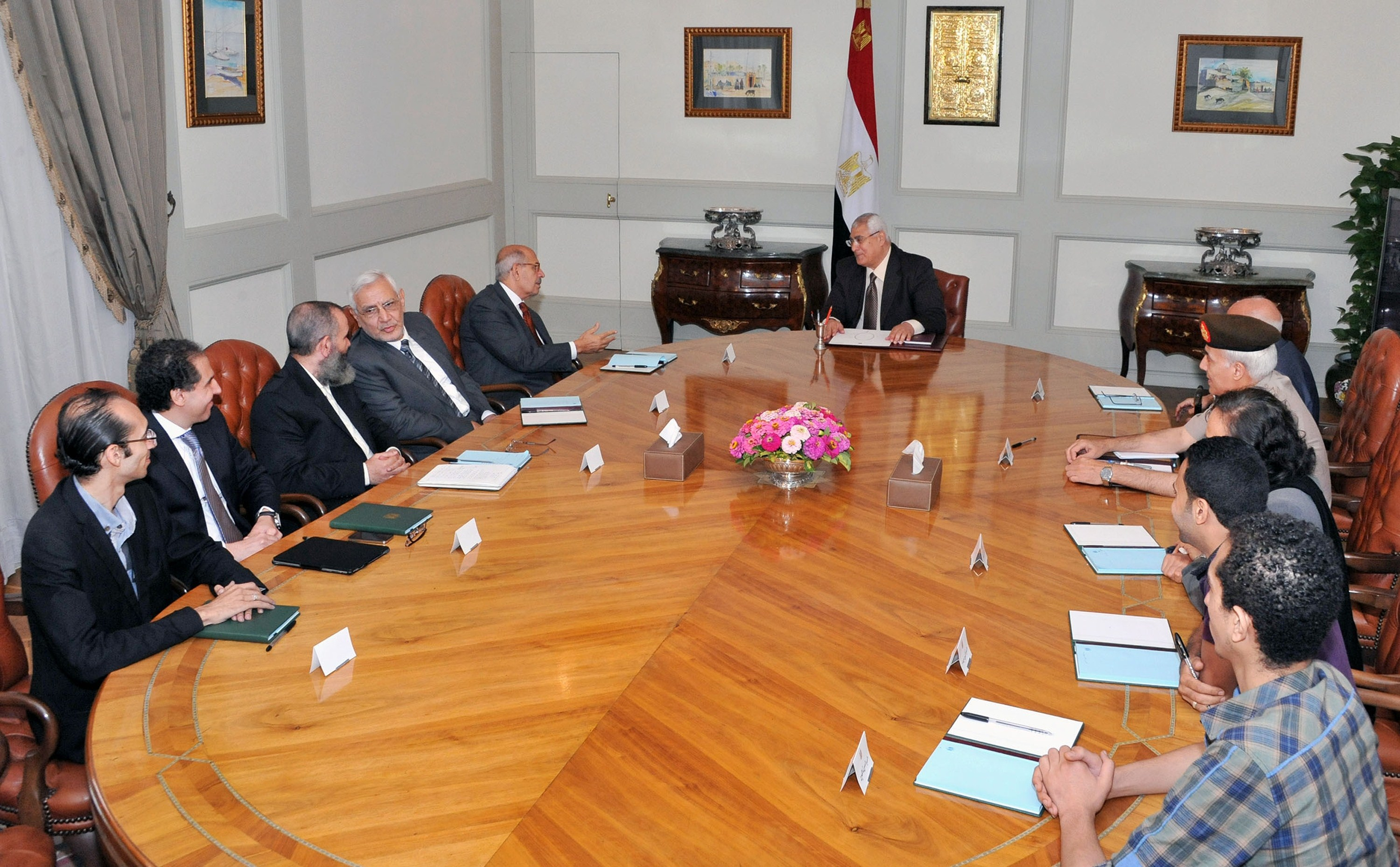 A handout picture released by the Egyptian Presidency shows Egypt's interim president Adly Mansour (C) meeting with opposition National Salvation Front leader Mohamed El Baradei (5thL) and heads of opposition Tamarod (Rebellion) group and other opposition leaders on July 6, 2013 in Cairo.  (AFP Photo)