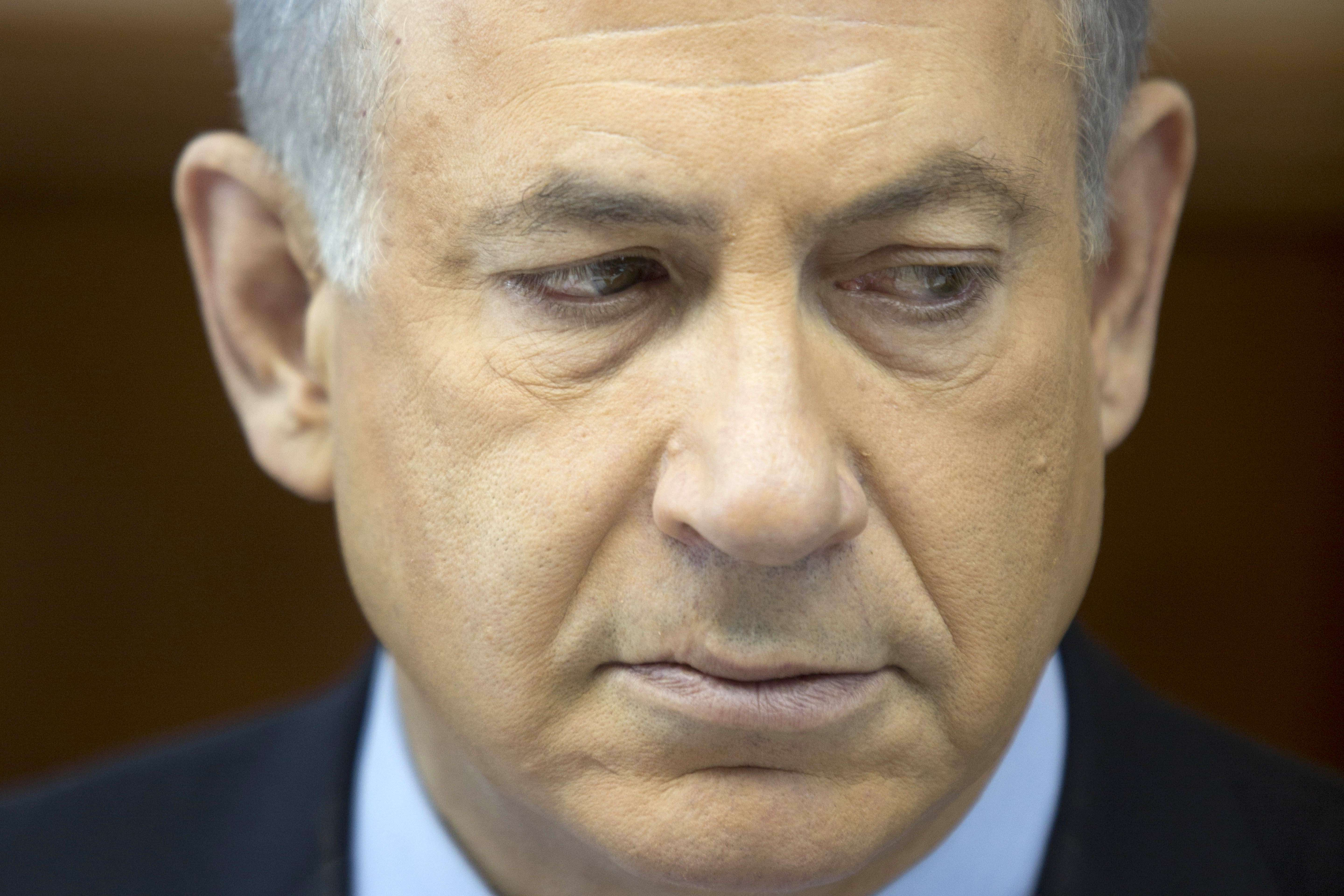 "Israeli Prime Minister Benjamin Netanyahu looks on during the weekly cabinet meeting on Sunday at his office in Jerusalem. Netanyahu slammed a nuclear deal between Iran and world powers as a ""historic mistake"", his spokesman said.(AFP PHOTO)"