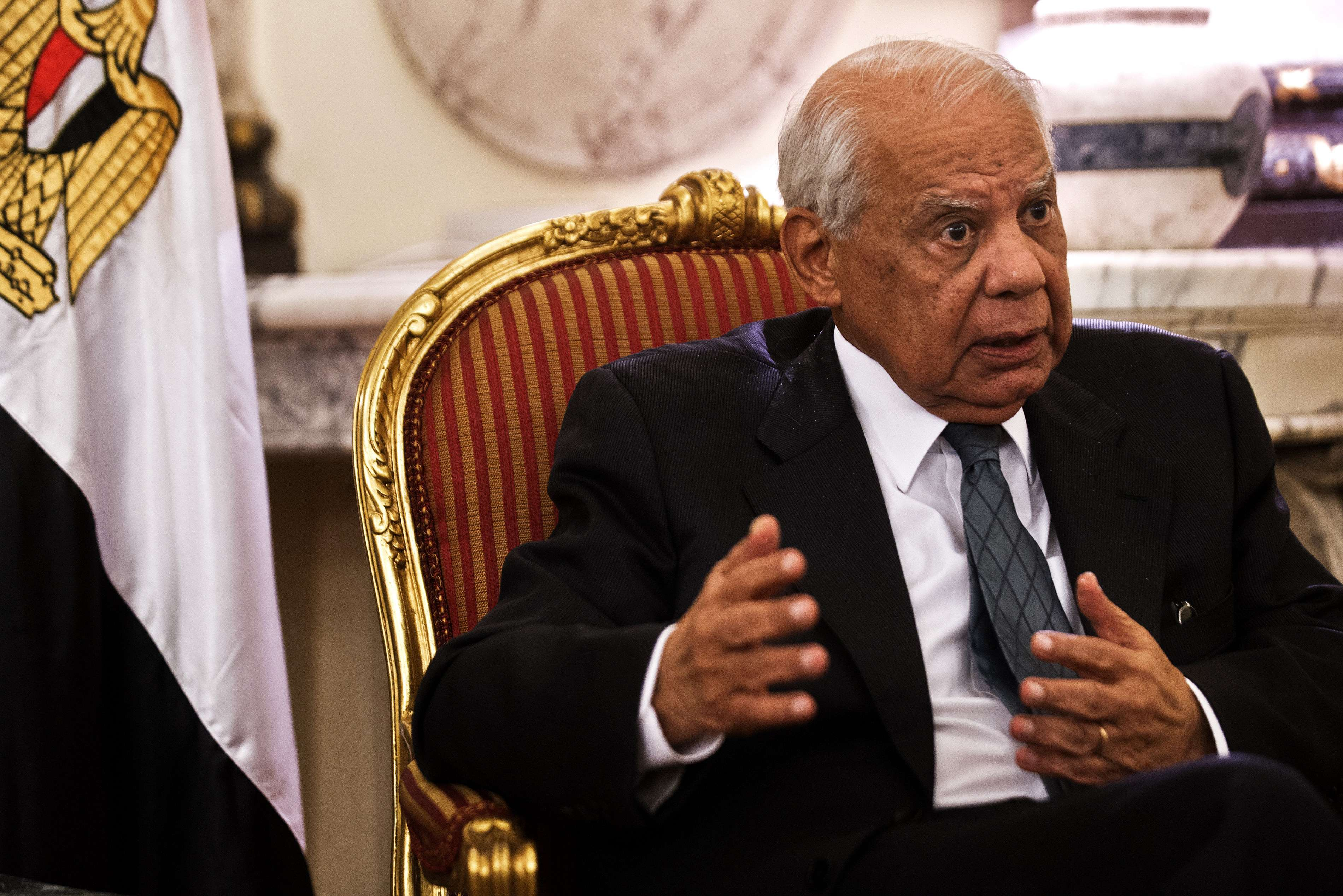 Egypt's interim prime minister Hazem Beblawi gives an interview to an Agence France-Presse journalist at his office in Cairo on November 24, 2013 as Egypt's interim president approved a controversial law regulating demonstrations.  (AFP PHOTO/GIANLUIGI GUERCIA)