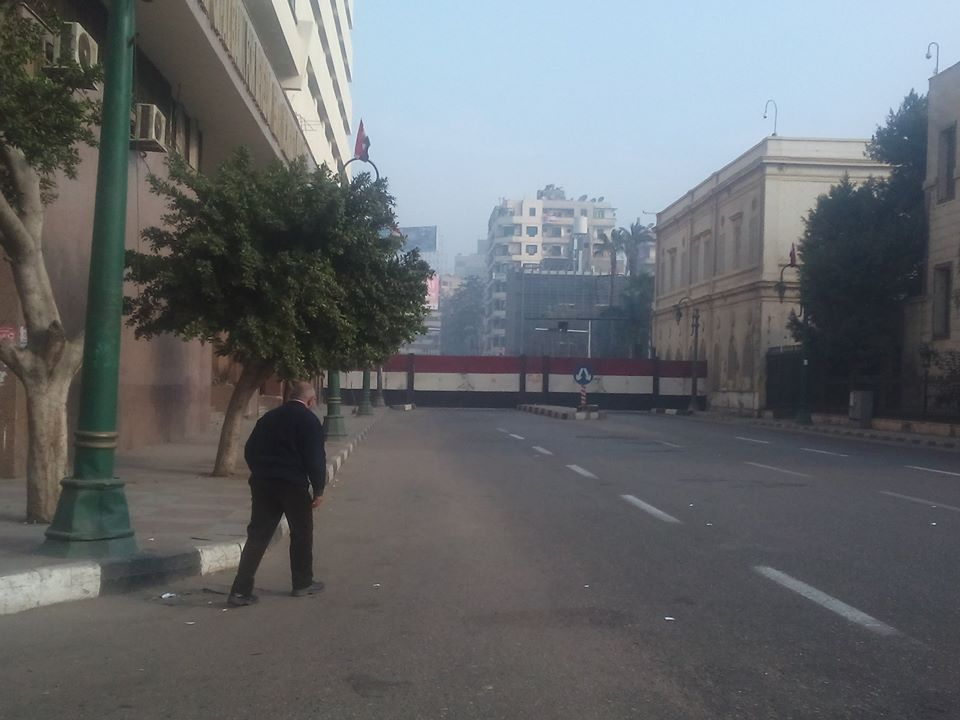 The doors on Qasr Al-Eini Street toward Tahrir Square closed on Sunday morning, anticipating protests on the 25 January Revolution anniversary (Photo by Mahmoud Mostafa)