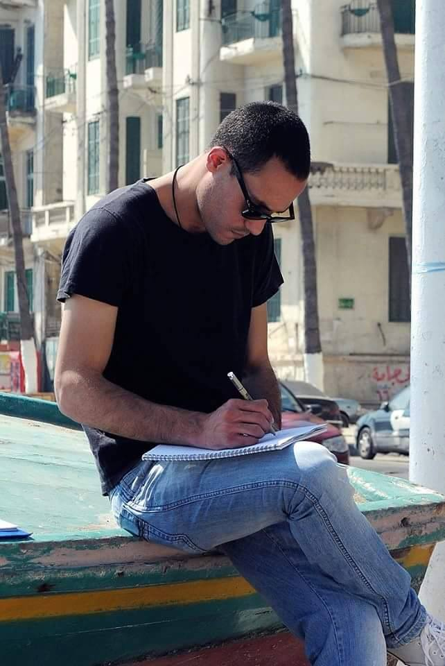 One of the architects while sketching an image of the buildings (Facebook photo)