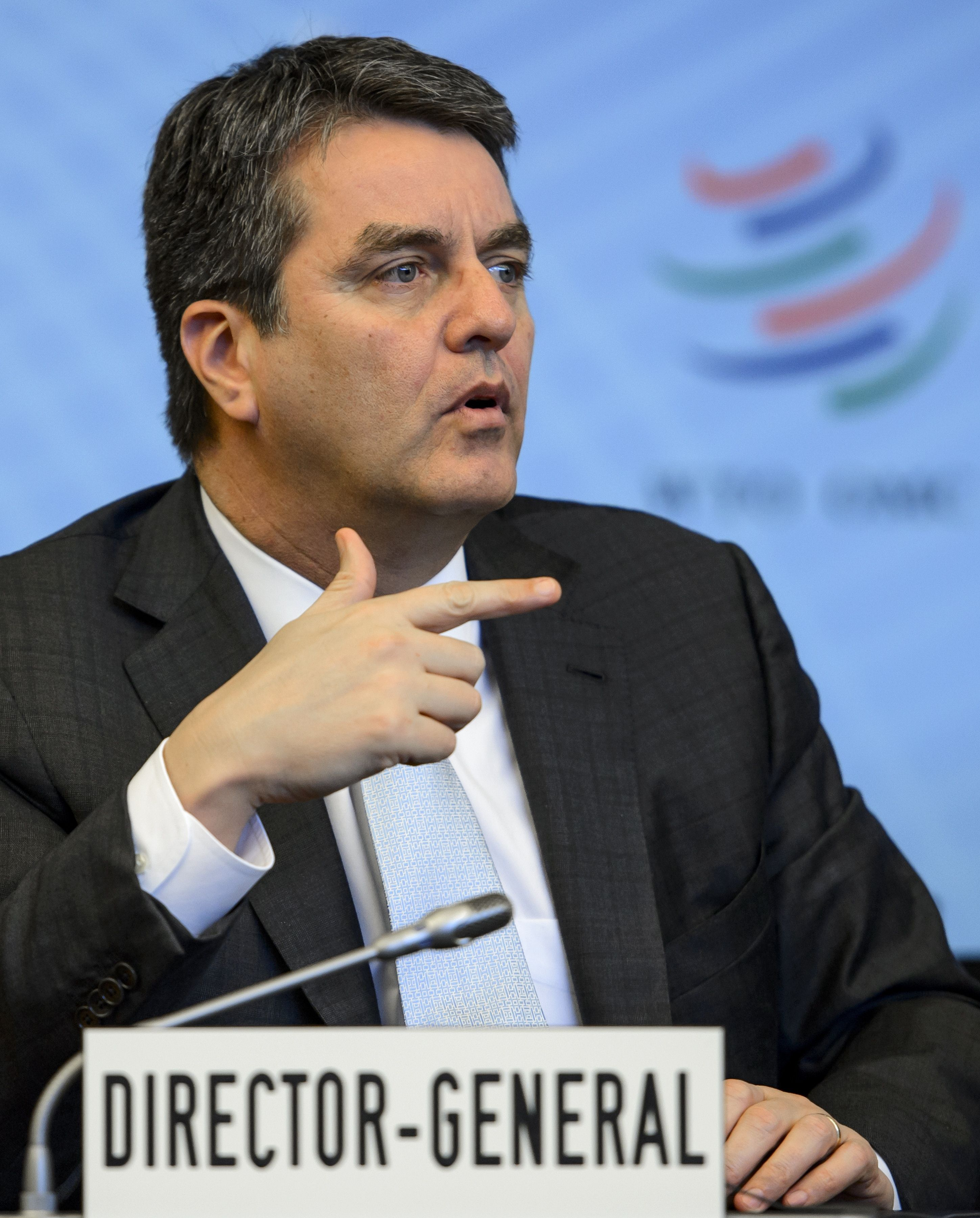 World Trade Organization (WTO) Director-General Roberto Azevedo of Brazil gestures on November 26, 2013 in Geneva after a crunch general council meeting to decide whether they could put a deal on the table at a make or break summit next month.  (AFP PHOTO / FABRICE COFFRINI)