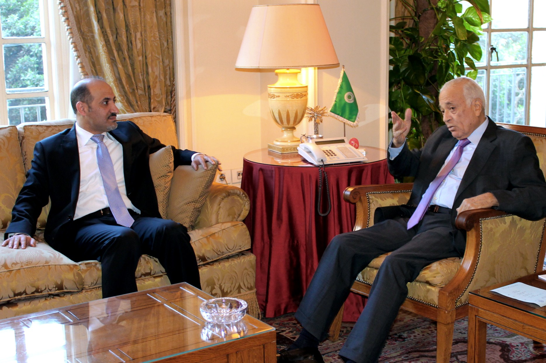 Arab League general secretary Nabil al-Arabi (R) meets with the Syrian opposition chief Ahmed Jarba in Cairo on November 26, 2013.  (AFP PHOTO/STR)