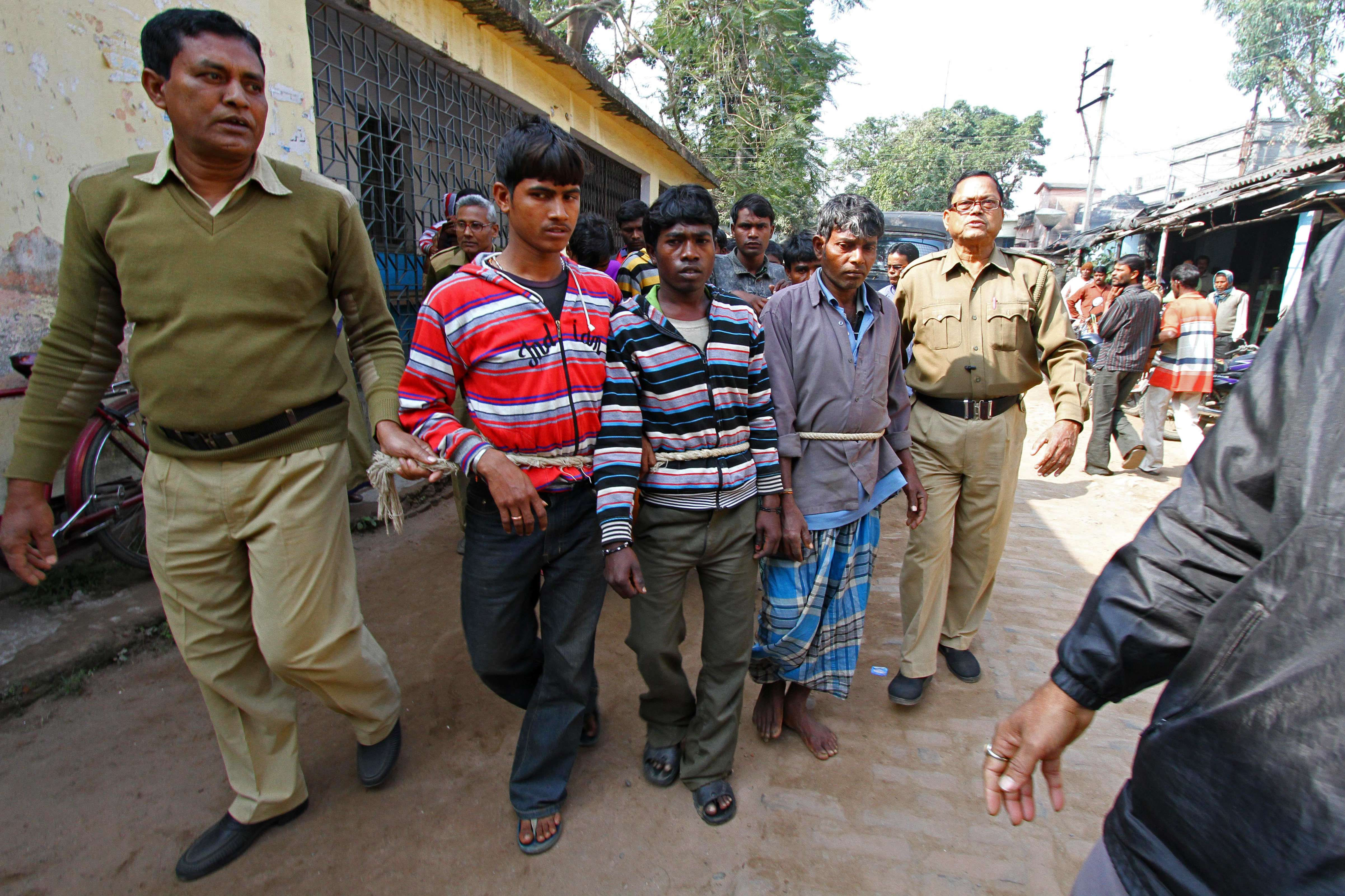 Suspects in a gang-rape case are led by police to a district courthouse in Birdhum district near the village of Subalpur, on 23 January  2014. (AFP Photo)