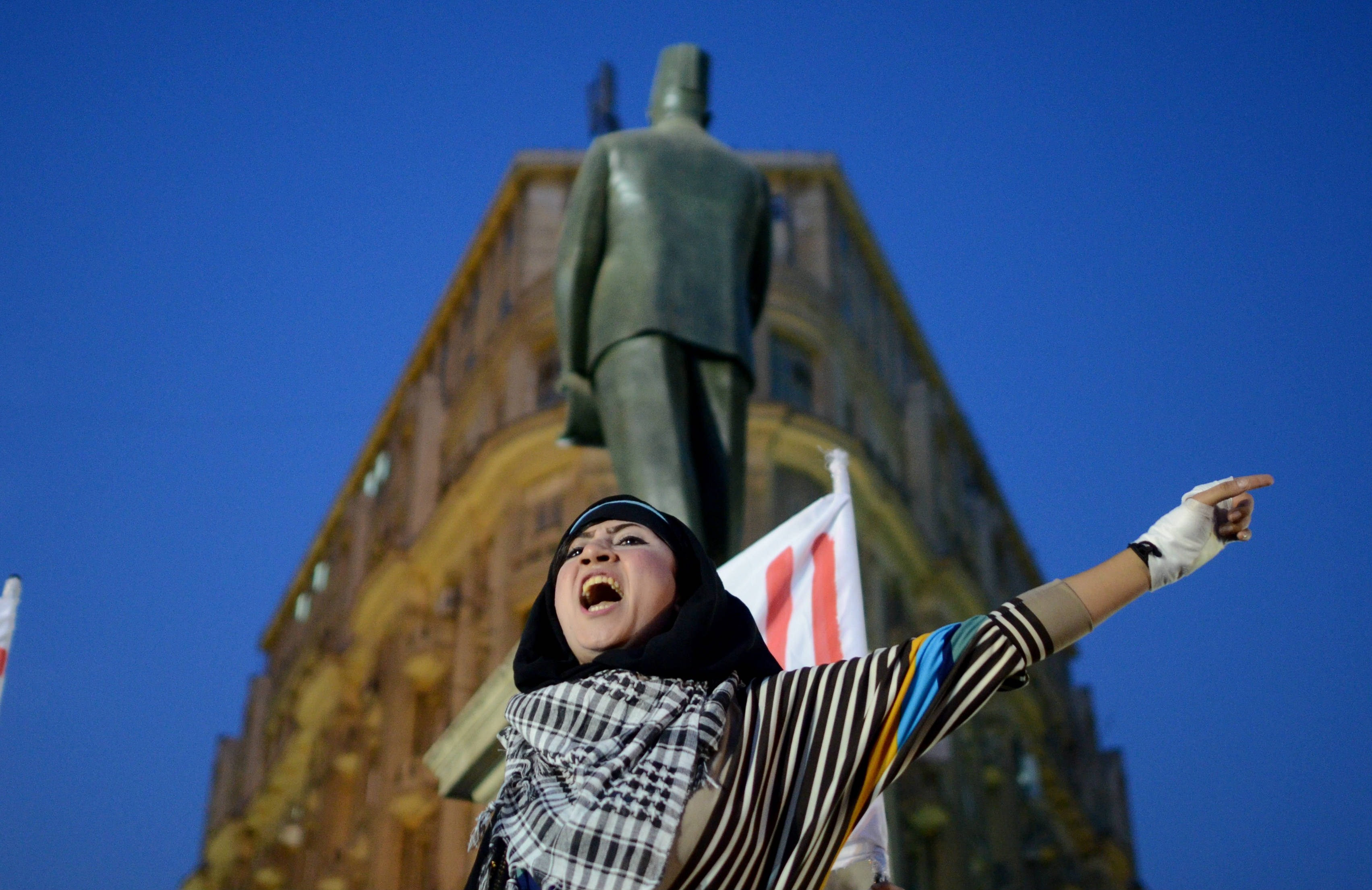 A protestor shouts slogans at Talaat Harb Square, downtown Cairo on November 28, 2013, during a demonstration to protest against a new law which regulates demonstrations.     (AFP PHOTO / MOHAMED EL-SHAHED)