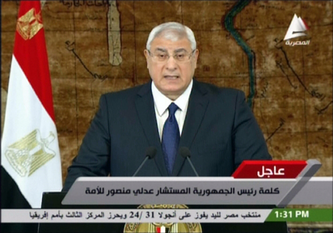 "An image grab taken from Egyptian state TV on January 26, 2014, shows Egypt interim president Adly Mansour giving a speech in Cairo. Four Egyptian soldiers were killed and nine wounded in attacks on the army in the restive Sinai Peninsula, security officials said. Militant attacks in the region have killed scores of Egyptian soldiers and policemen since the military overthrew Islamist president Mohamed Morsi in July.  AFP PHOTO / EGYPTIAN TV  == RESTRICTED TO EDITORIAL USE - MANDATORY CREDIT ""AFP PHOTO / EGYPTIAN TV"" - NO MARKETING NO ADVERTISING CAMPAIGNS - DISTRIBUTED AS A SERVICE TO CLIENTS ==="