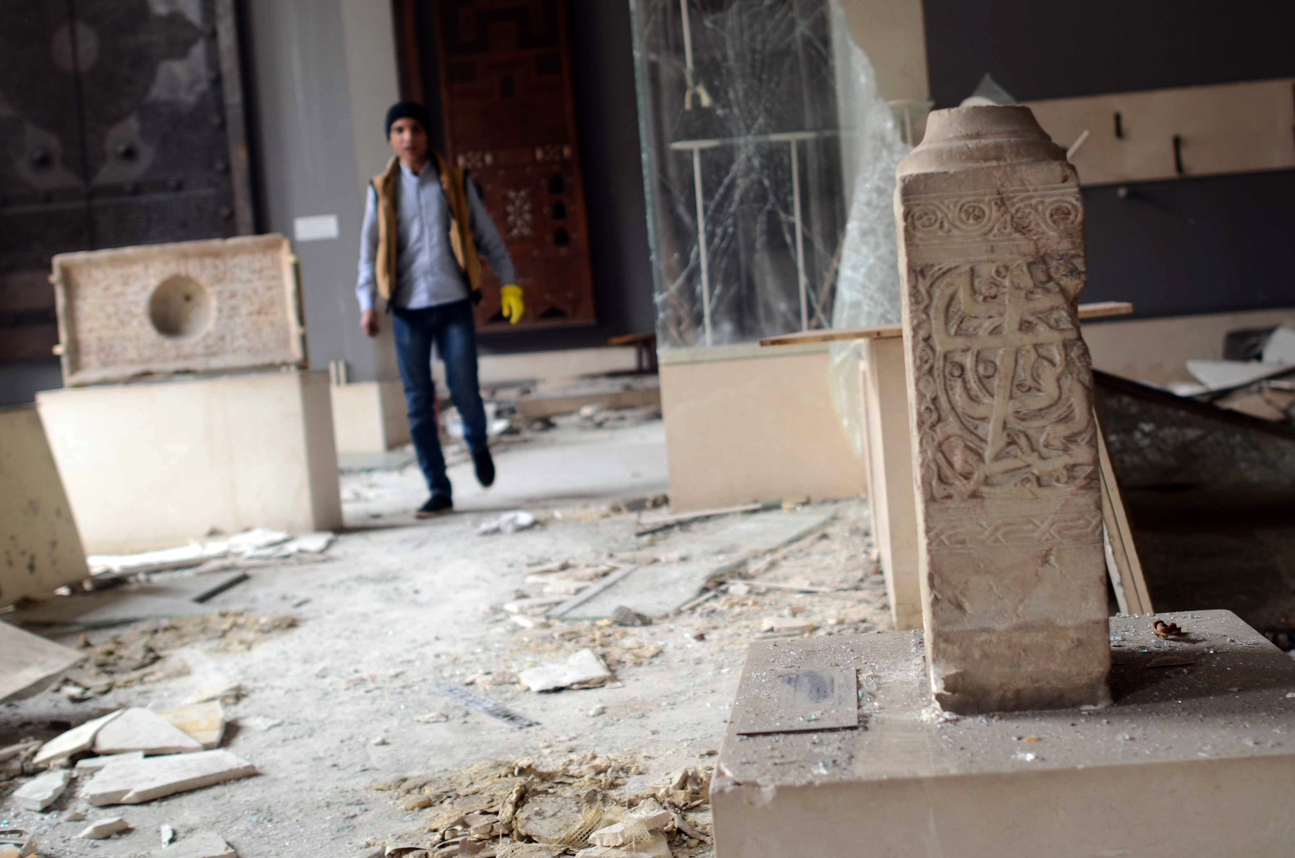 A worker inspects the damage in the Museum of Islamic Art in Cairo on January 26, 2014 after it was hit during a car bomb explosion outside the police headquarters near the museum on January 24 in the capital. The explosion, which happened on the eve of of the anniversary of the 2011 uprising, brought down the museum's ceilings and damaged exhibits.  (AFP PHOTO / MOHAMED EL-SHAHED)
