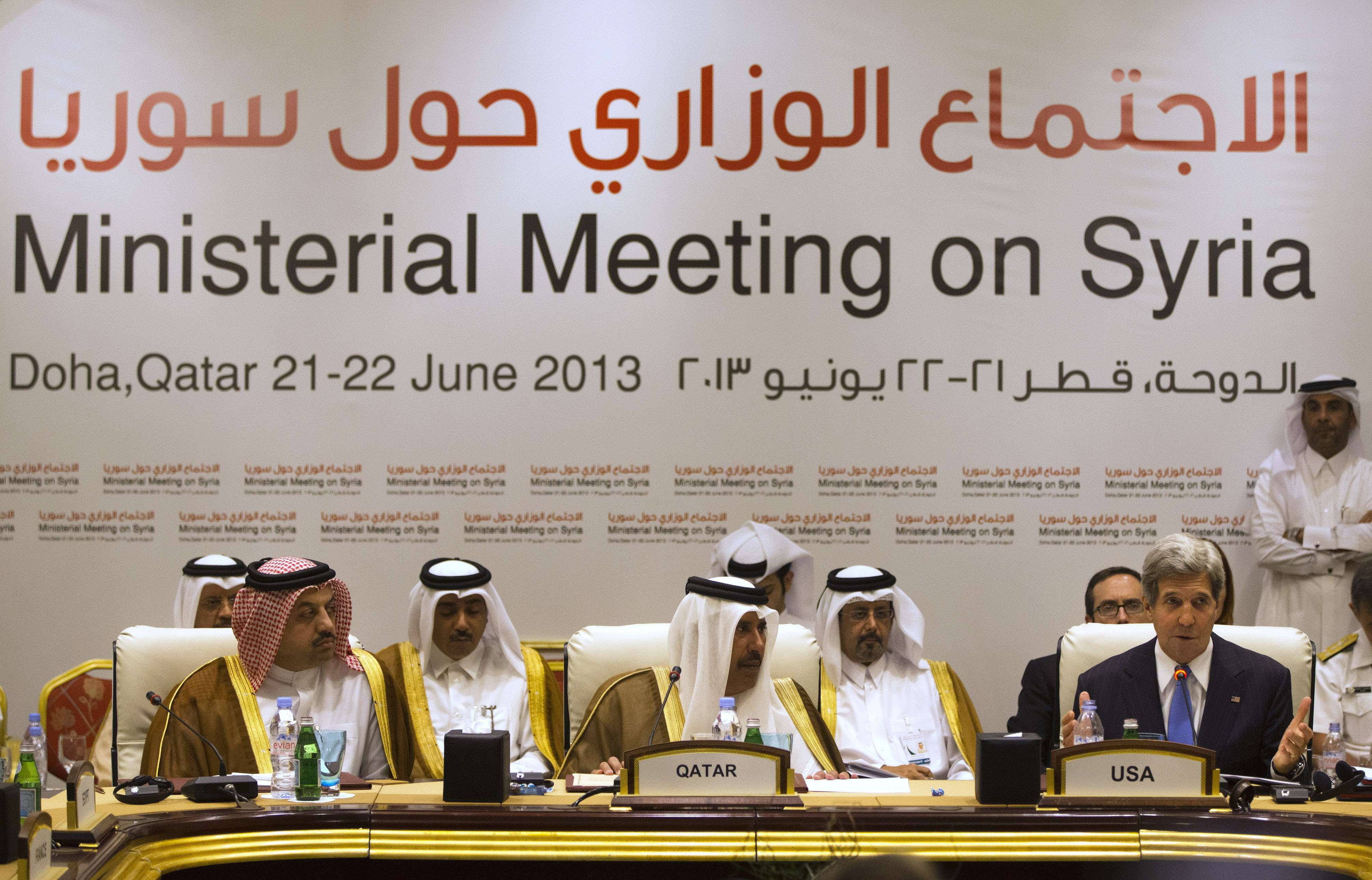 """Khalid al-Attiyah (LL, Qatari acting minister of business and trade, and Qatari Prime Minister and Foreign Minister Hamad bin Jassim bin Jaber al-Thani, listen as U.S. Secretary of State John Kerry as he speaks during a meeting of the London 11 """"Friends of Syria""""  in Doha, on June 22, 2013.  (AFP Photo)"""