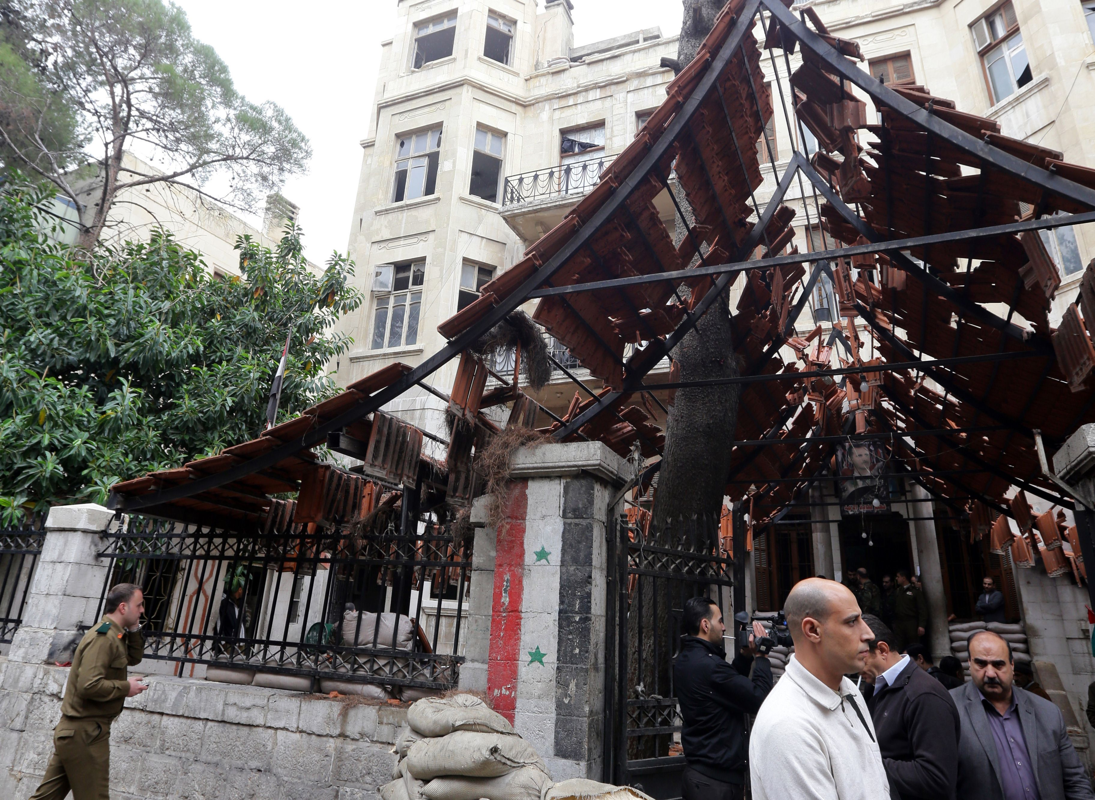 A general view shows damage at the scene of a suicide attack  in central Damascus on December 3, 2013.  (AFP PHOTO/ LOUAI BESHARA)