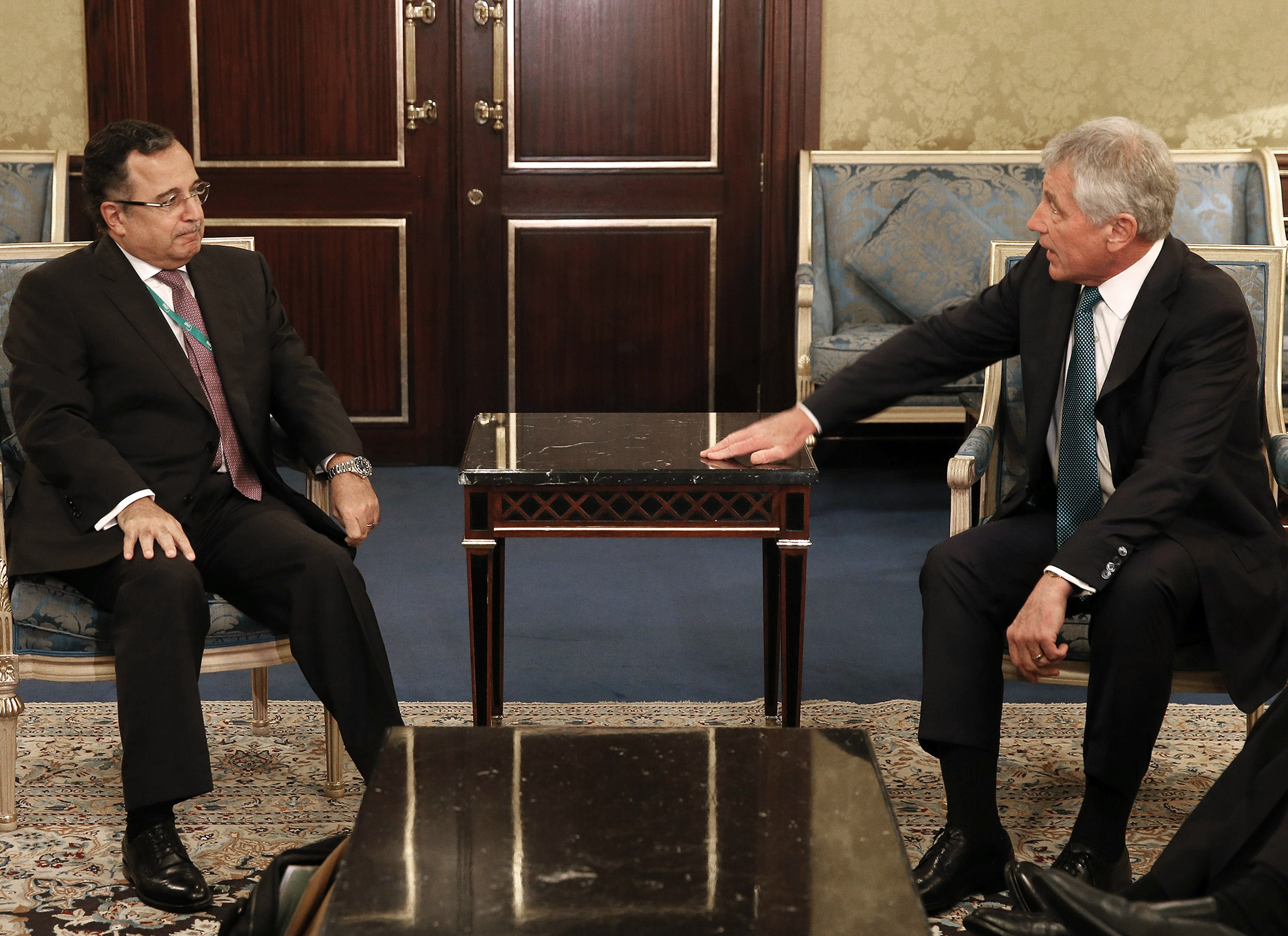 US Defence Secretary Chuck Hagel (R) meets with Egypt's Foreign Minister Nabil Fahmy during the 9th International Institute for Strategic Studies (IISS) Regional Security Summit in the Bahraini capital Manama on December 7, 2013.  (AFP PHOTO / POOL / MARK)