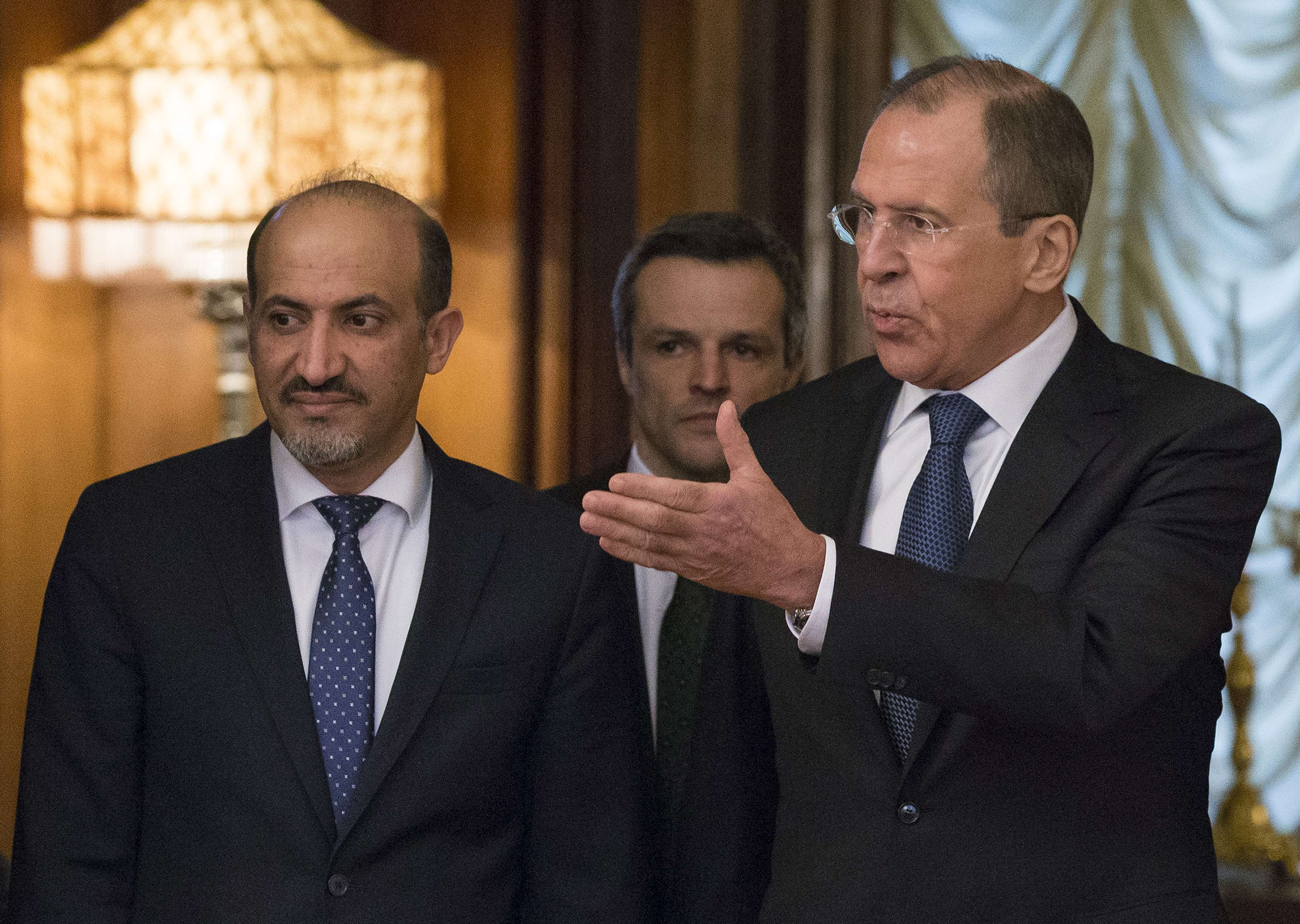 Russia's Foreign Minister Sergei Lavrov (R) and Syrian opposition leader Ahmad Jarba meet in Moscow February 4, 2014. Syria's opposition leader met today Russia's top diplomat in a bid to persuade Moscow to push its ally Damascus to agree to a transitional government for the war-scarred nation.  (AFP PHOTO)
