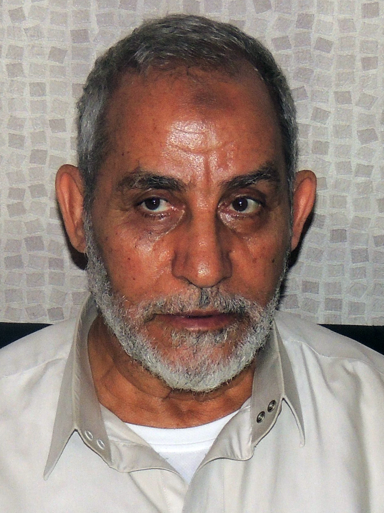 Mohamed Badie the supreme guide of the Muslim Brotherhood, following his arrest in the early hours of August 20, 2013 in Cairo's Nasr City district.  (AFP PHOTO)