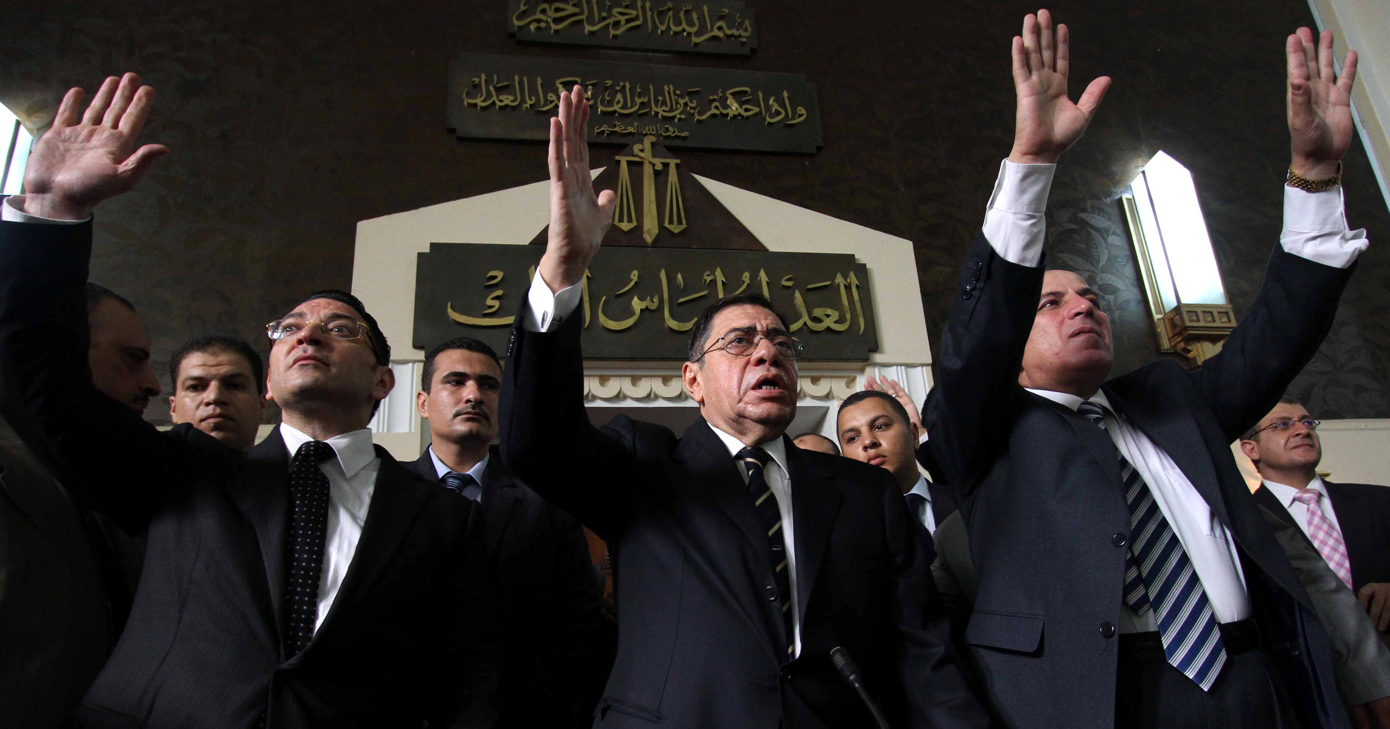 Egyptian General Prosecutor Abdel Meguid Mahmud (C) addresses judges in his office at the high court in Cairo on October 13, 2012. An influential group of Egyptian judges backed state prosecutor Mahmud's refusal to resign after President Morsi ordered his removal on October 11. (Photo credit should read AHMED MAHMUD/AFP/Getty Images)
