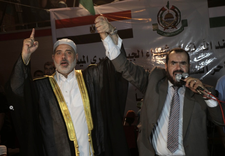 Muslim Brotherhood Salah Sultan (right) was detained while attempting to travel to Khartoum on Sunday. (AFP Photo)