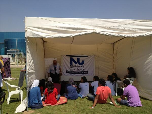 Nile University student attending a lecture during the encampment they set up outside the disputed buildings in September 2012. (Photo Courtesy of the 'Save Nile University' twitter account)