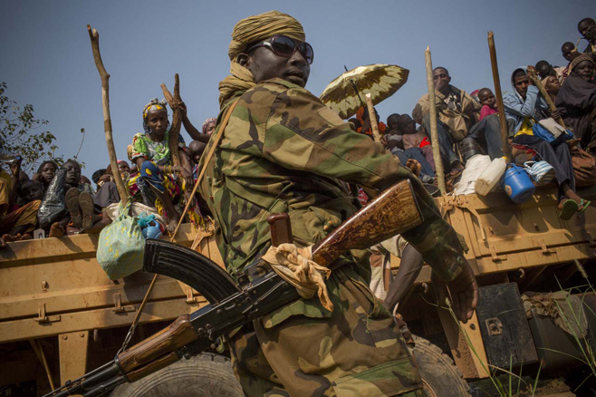 Muslims flee the town of Bangui aided by Chadian Special Forces on 7 February  (Photo by Marcus Bleasdale/VII /Courtesy of  Human Rights Watch)