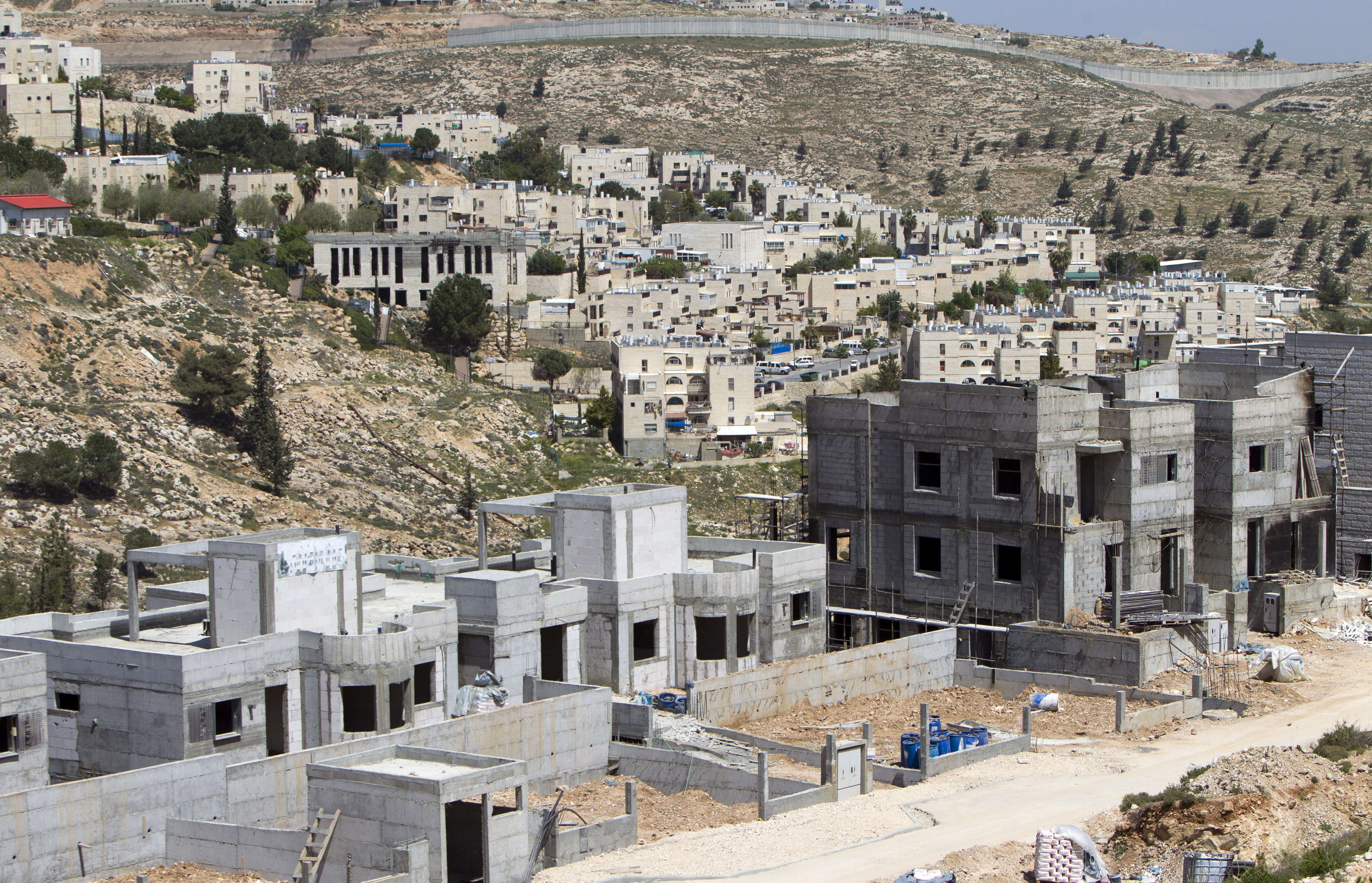 Settlement activities in the Occupied Palestinian Territories and the Golan Heights, both occupied since 1967, are considered illegal in international law. (AFP PHOTO/AHMAD GHARABLI)