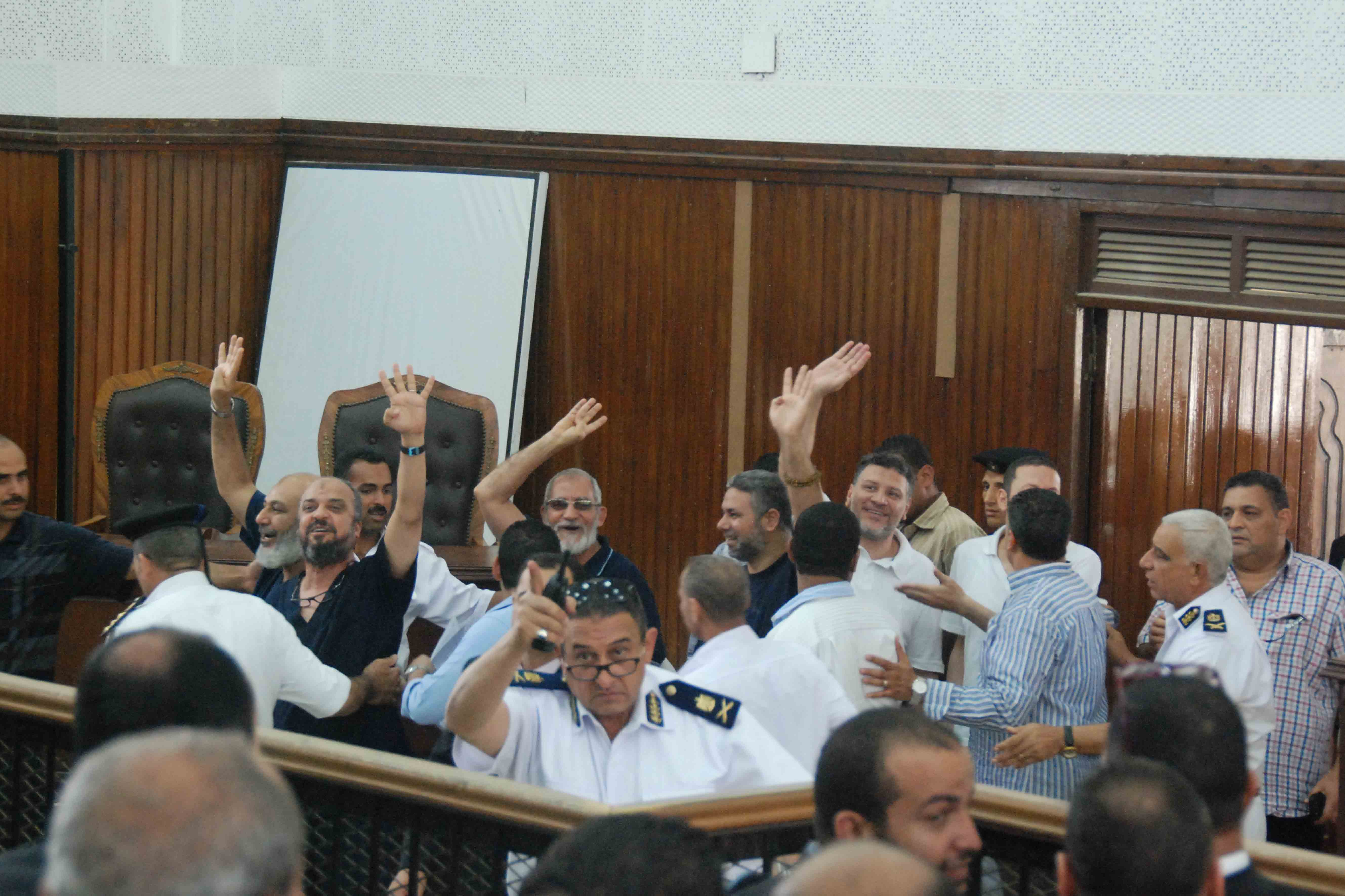 Supreme Guide of the Muslim Brotherhood Mohamed Badie, senior FJP member Mohamed AL-Beltagy, conservative preacher Safwat Hegazy, and other defendants arrive to court on Saturday. (Photo by Ahmed Al-Malky)