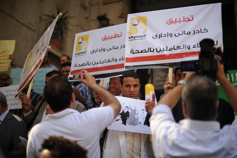 Doctors have been demonstrating against deteriorating health system conditions for over seven months. Photo shows striking doctors demonstrating outside of the Doctor's Syndicate building on Qasr Al-Eini Street (Laurence Underhill/ File Photo)