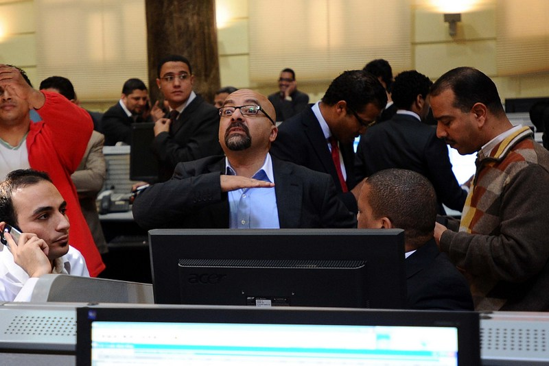 Egypt's stock exchange reacts to exacerbating political scene and MSCI announcement through falling to a year low adding to investors' concerns. (AFP File Photo)