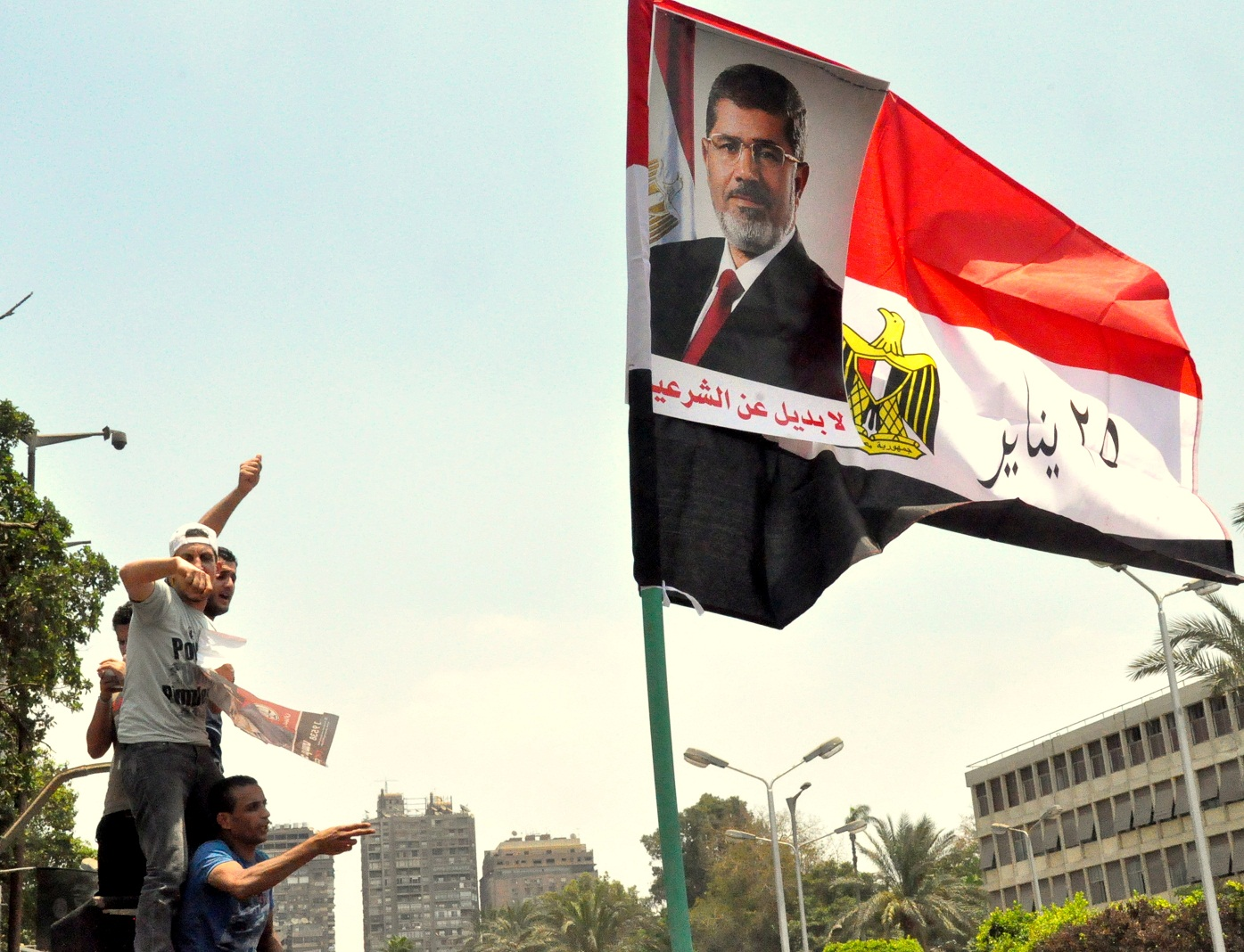 Hundreds of supporters of President Mohamed Morsi gathered in front of Cairo University as nationwide demonstrations continued into Tuesday. (Photo by Aaron T. Rose)