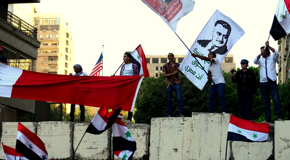 Protestors waved Syrian flags and banners with pictures of Egyptian President Gamal Abdel-Nasser—harkening back to the days of the United Arab Republic. (Pgoto by Aaron T.rose)