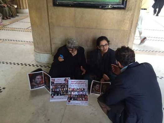 Activist Leila Seif held a sit-in at the Supreme Judicial Council Wednesday protesting the imprisonment of her son Alaa Abdel Fattah and daughter Sanaa Seif (Photo from The Freedom for the Brave movement)