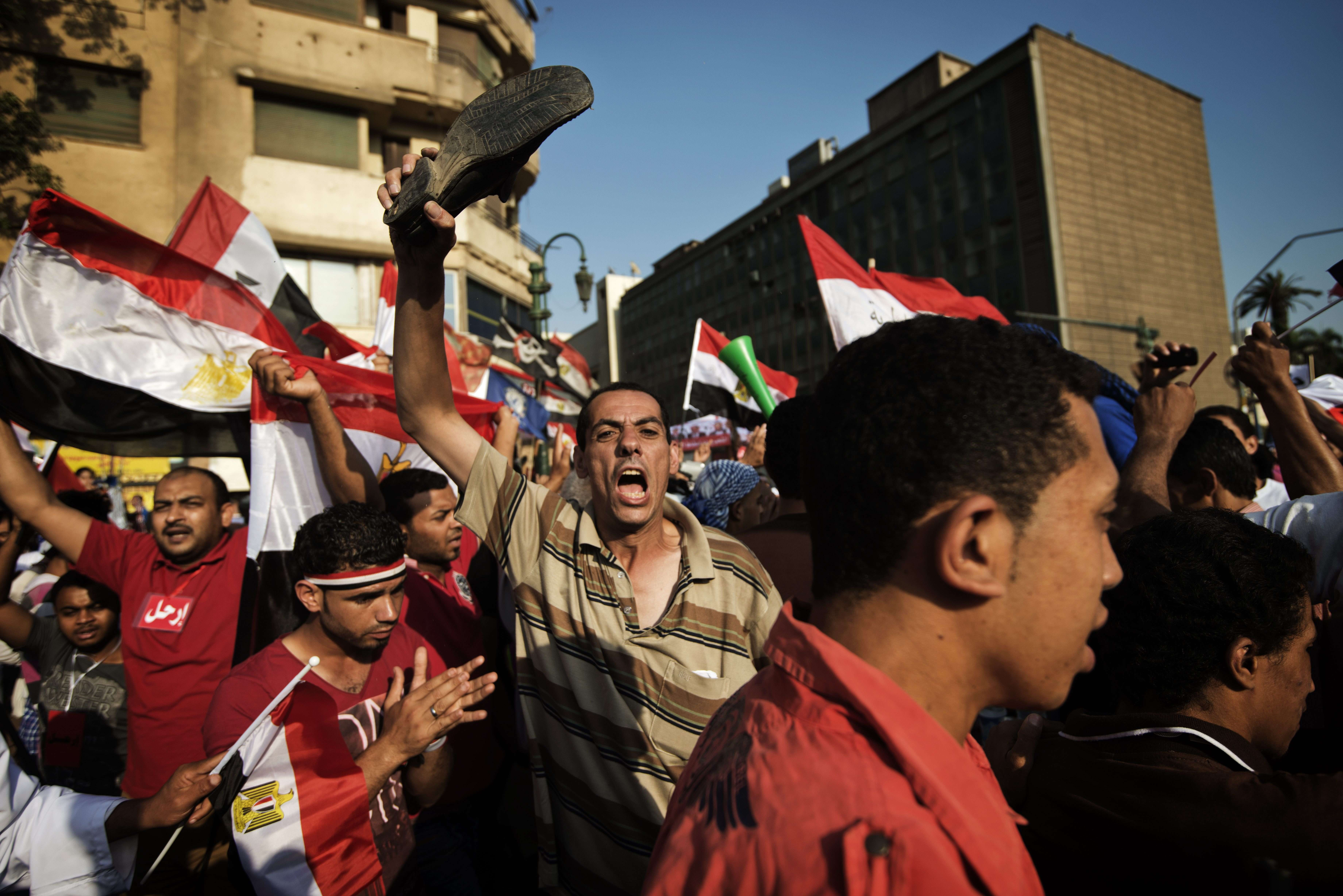 Egyptian opposition protesters celebrate on July 1, 2013 in Cairo's landmark Tahrir square (AFP Photo)