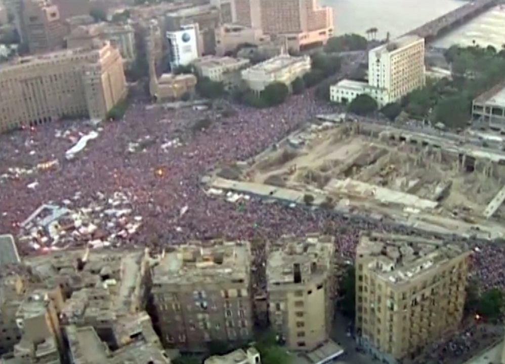 frame grab taken from AFPTV footage shows hundreds of thousands of Egyptian demonstrators gathering in Cair's Tahrir square during a protest calling for the ouster of President Mohamed Morsi on June 30, 2013. (AFP Photo)