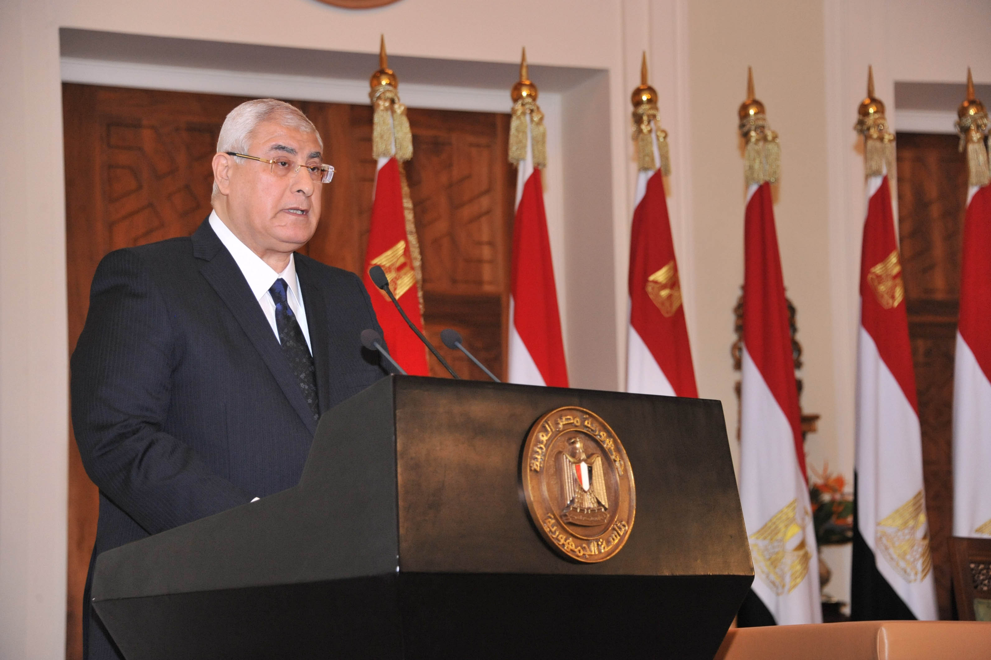 "A handout picture released by Egyptian presidency shows Egypt's interim president Adly Mansour annoucing that a referendum on a new draft constitution will be held next month, during a press conference in Cairo on December 14, 2013. The constitutional referendum is to be followed by parliamentary and presidential elections in mid-2014, according to a transition road map outlined by the new military-installed authorities.  AFP PHOTO / HO / EGYPTIAN PRESIDENCY === RESTRICTED TO EDITORIAL USE - MANDATORY CREDIT ""AFP PHOTO/HO/EGYPTIAN PRESIDENCY"" - NO MARKETING NO ADVERTISING CAMPAIGNS - DISTRIBUTED AS A SERVICE TO CLIENTS ==="