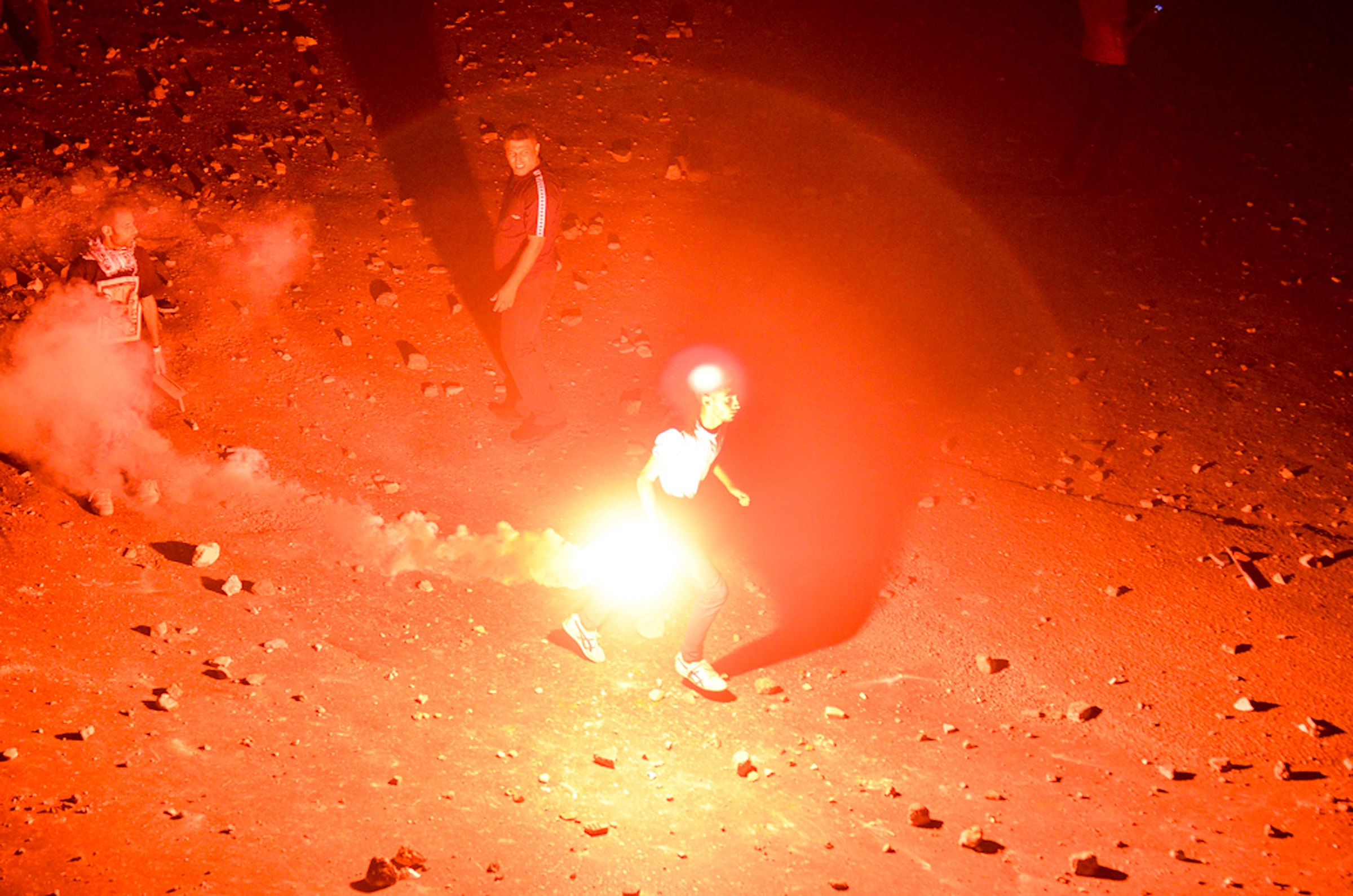 A man holds a flare during clashes between supporters of ousted president Mohammed Morsi and anti Morsi protesters near Egypt's landmark Tahrir square on July 5, 2013 in Cairo. (AFP Photo)