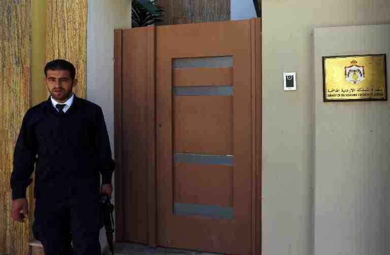 Security guard stands outside Jordanian embassy in the Libyan capital after gunmen traveling in two cars on April 15, 2014 abducted the Jordanian ambassador to Tripoli, Fawaz Aitan, in an attack that left his driver wounded, Libyan authorities said  (AFP Photo/Mahmud Turkia)