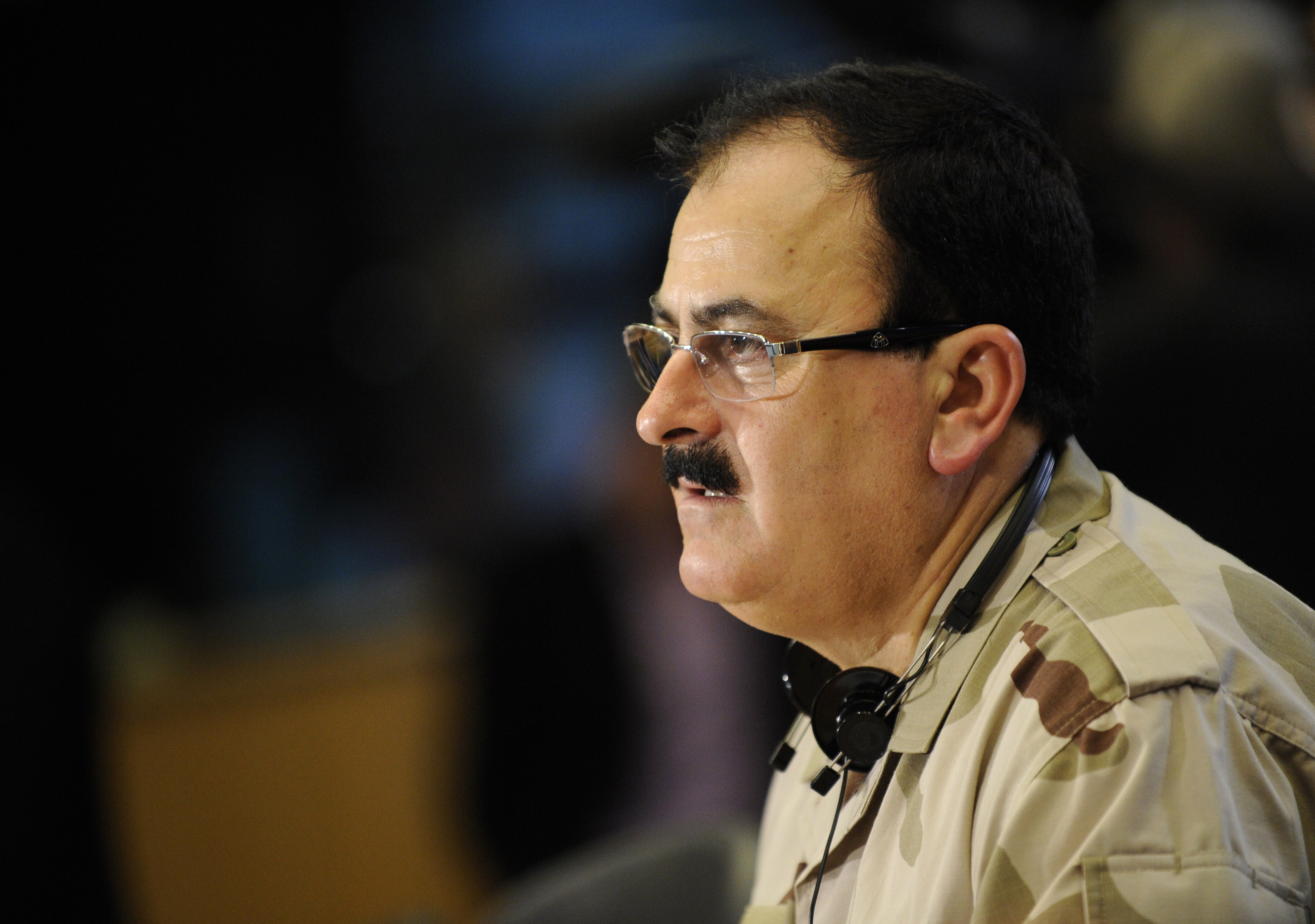 "This photo taken on March 6, 2013, shows chief commander of the Free Syrian Army Brigadier General Selim Idriss speaking during a press confrence at the European Union Parliament in Brussels. The Free Syrian Army announced on February 16, 2014, it had fired Selim Idriss as its military chief and appointed Abdel al-Ilah al-Bachir to replace him. In a video broadcast on the Internet, the rebel coalition said its military council had decided to replace Idriss because of ""the difficulties faced by the Syrian revolution"" in its battle with President Bashar al-Assad's regime.   (AFP PHOTO / JOHN THYS)"