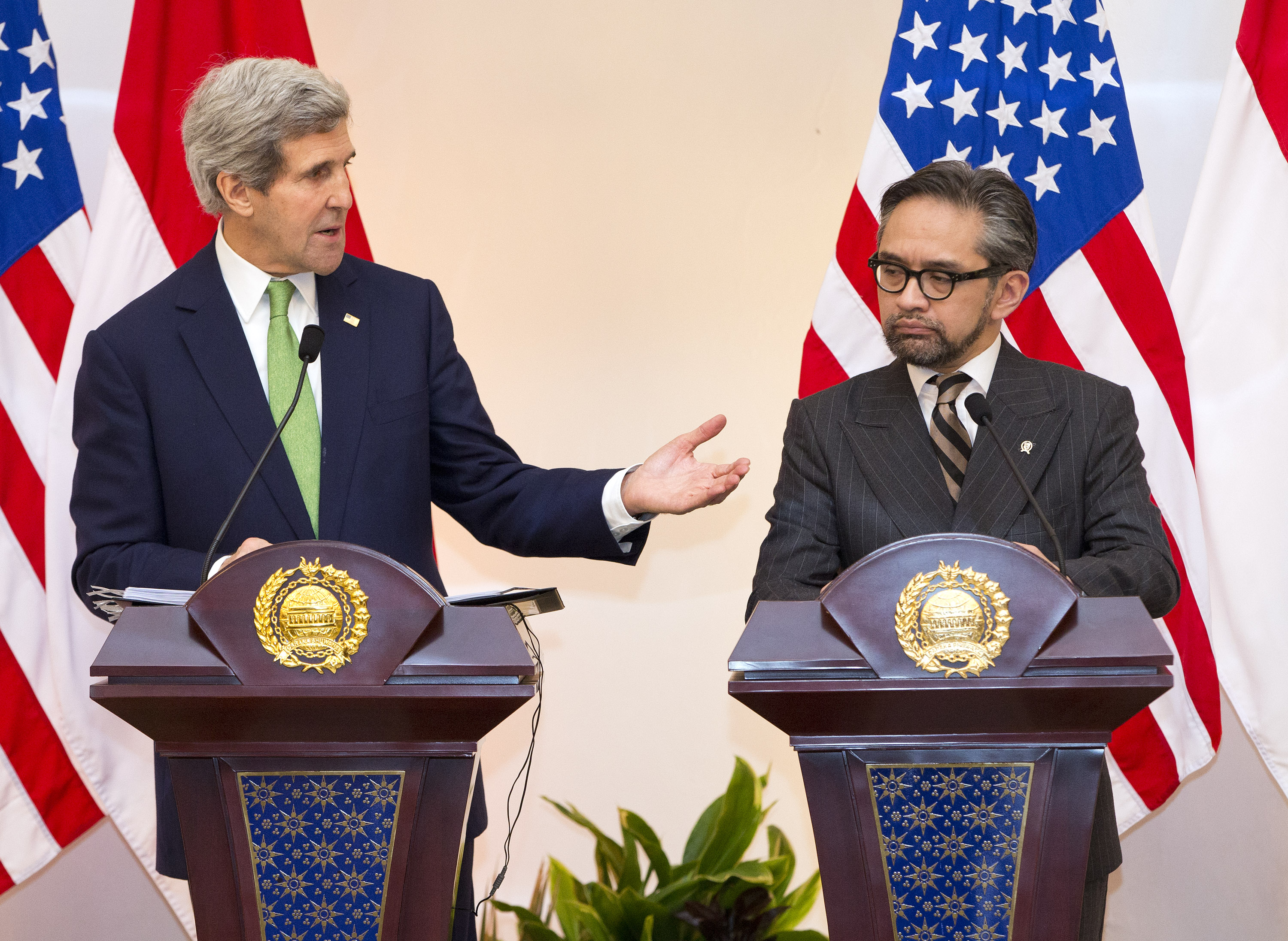 "US Secretary of State John Kerry (L) speaks during a news conference with Indonesian Foreign Minister Marty Natalegawa at the Pancasila in Jakarta on February 17, 2014. US Secretary of State John Kerry on February 16 issued a clarion call for nations to do to more to combat climate change, calling it ""the world's largest weapon of mass destruction"".    (AFP PHOTO / Evan Vucci / POOL)"