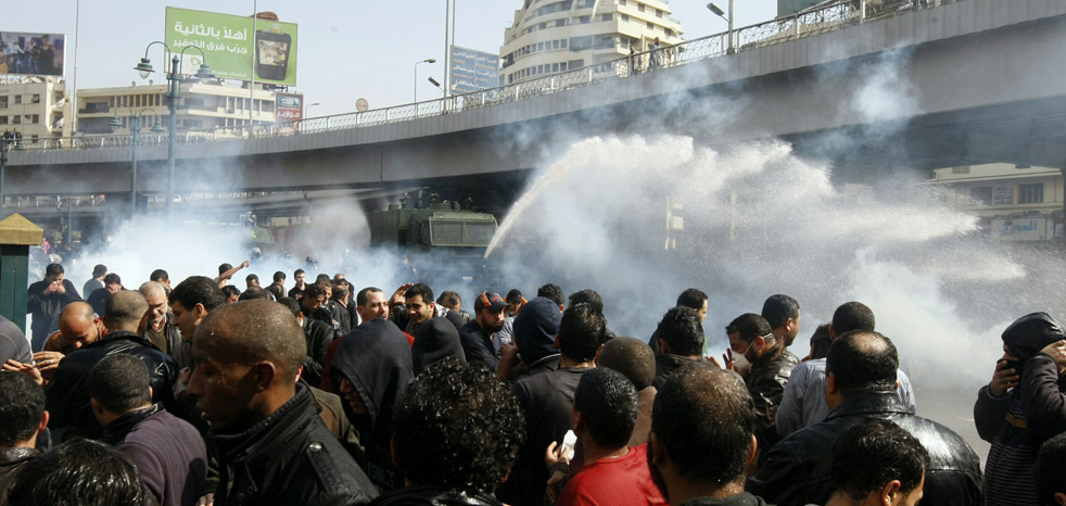 Egyptian demonstrators confront riot police during a demonstration in Cairo on January 28, 2011, demanding the ouster of President Hosni Mubarak.  (AFP/ Getty Images / Mohammed Abed)