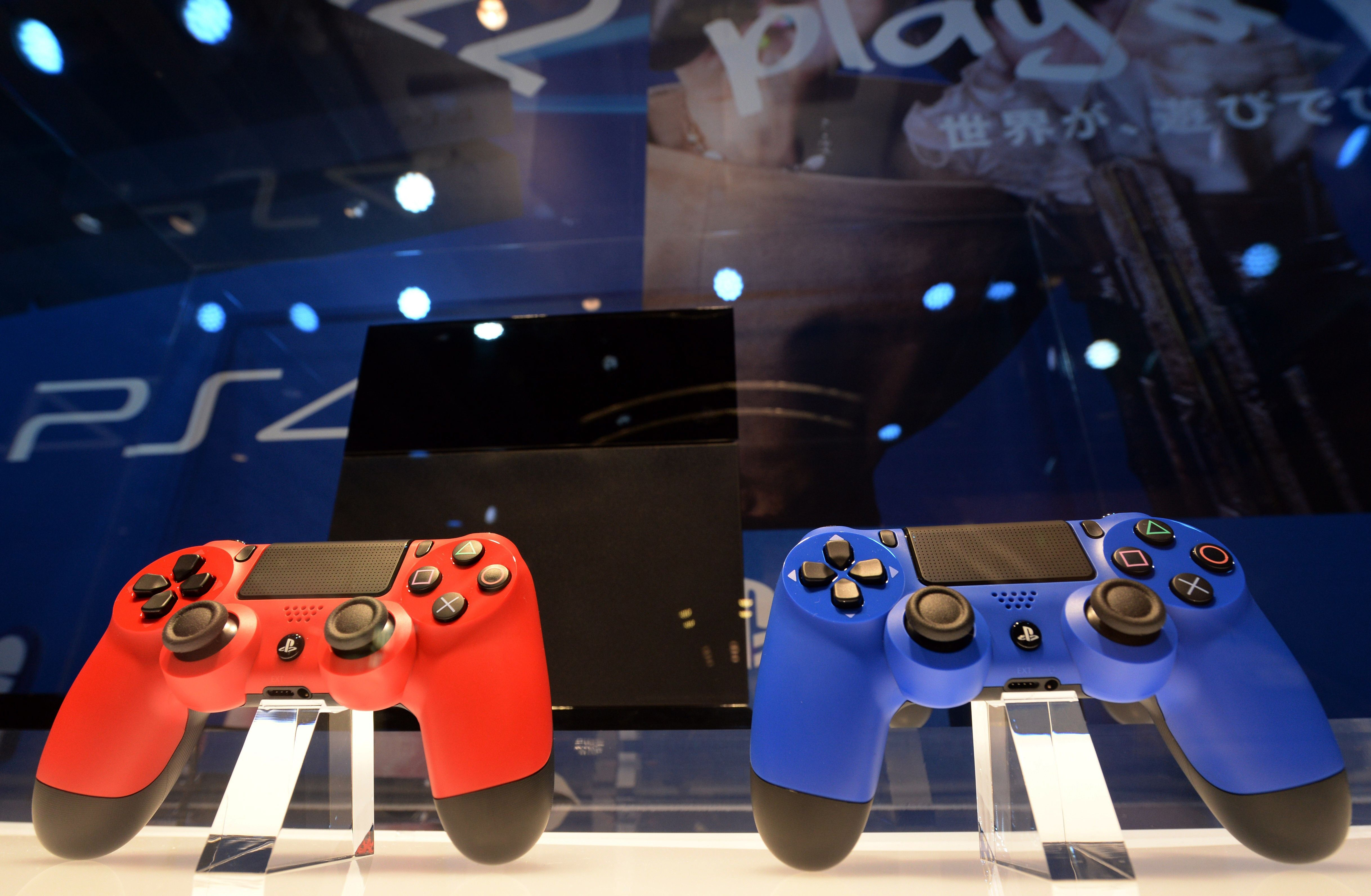 """This file picture taken on February 1, 2014 shows Sony's PlayStation 4 video game consoles, which will be launched in Japan on February 22, displayed at the """"Try! PlayStation 4! -2.22-"""" event at Ginza Sony building in Tokyo. Global sales of the PlayStation 4, launched in North America, South America and Europe end of last year, topped 5.3 million units as of February 8, Sony Computer Entertainment announced on February 18.      (AFP PHOTO / FILES / TOSHIFUMI KITAMURA)"""
