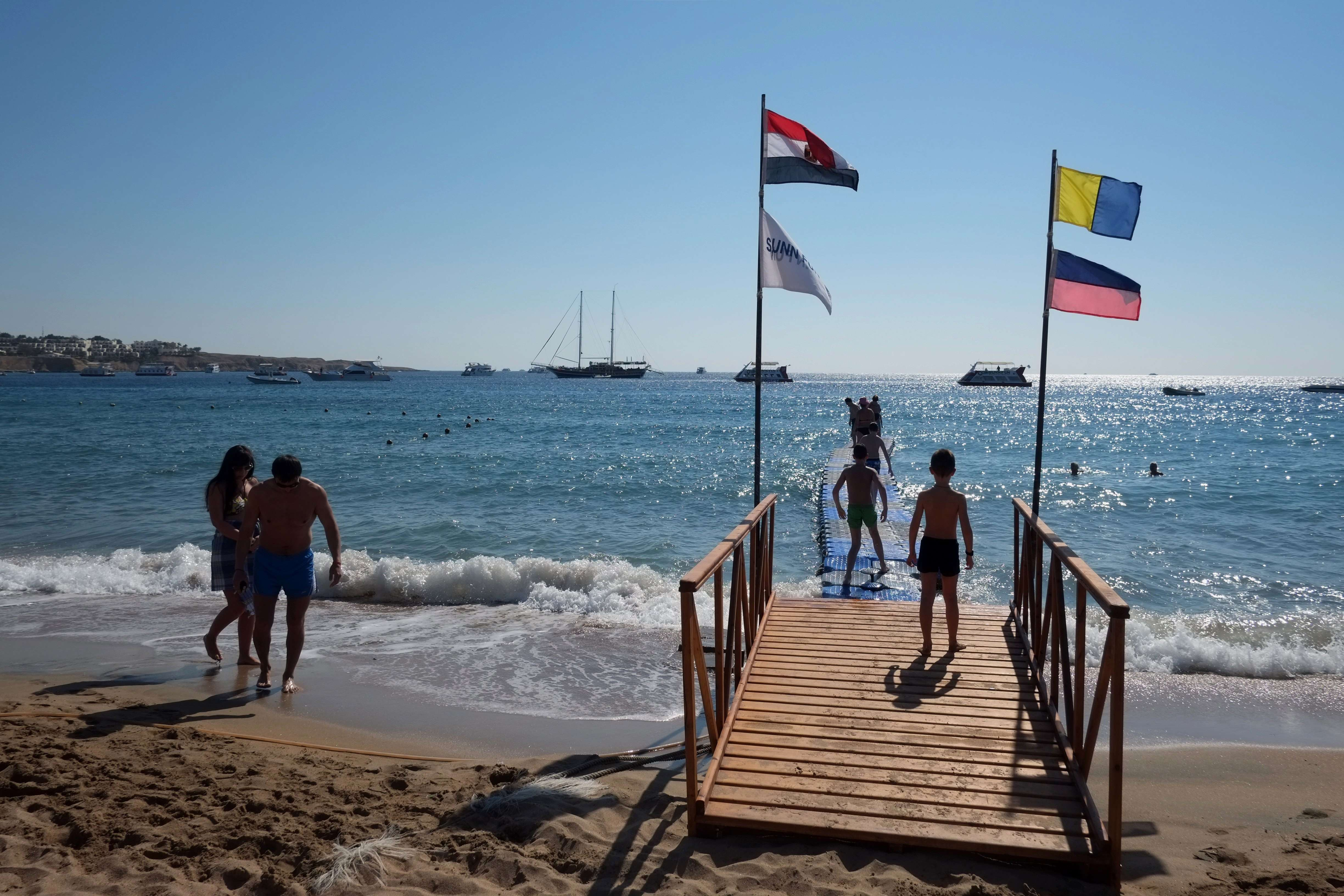 Tourists enjoy the beach in the Egyptian Red Sea resort of Sharm el-Sheikh on February 19, 2014. The decline in tourism since the fall of Egyptian president Hosni Mubarak has hobbled Egypt's economy .  (AFP PHOTO / KHALED DESOUKI)