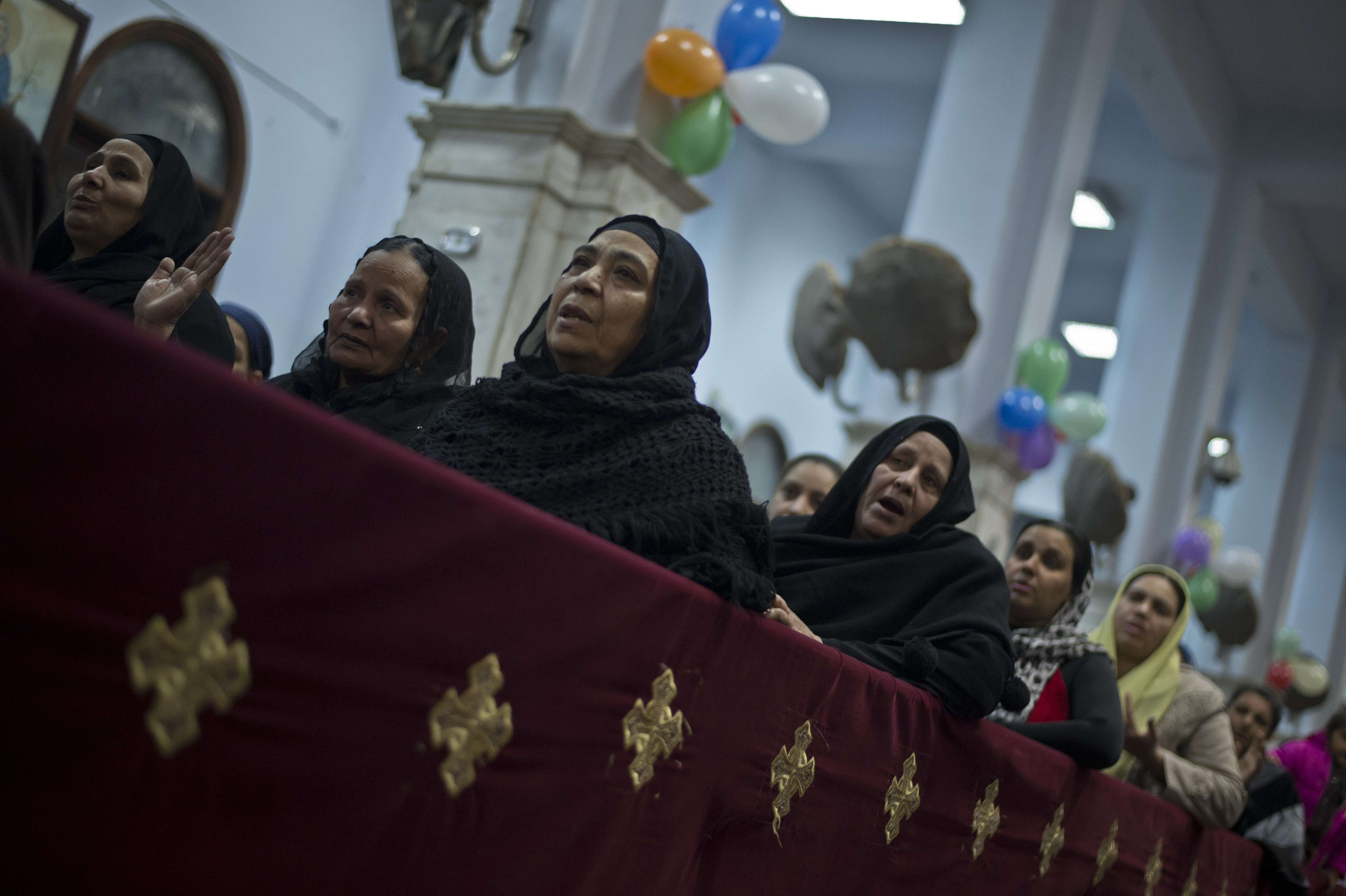 Egyptian Coptics attend the New Year mass service at the Virgin Mary Coptic Christian church in Cairo's working class neighborhood of Al-Warrak on December 31, 2013.    (AFP PHOTO / KHALED DESOUKI)