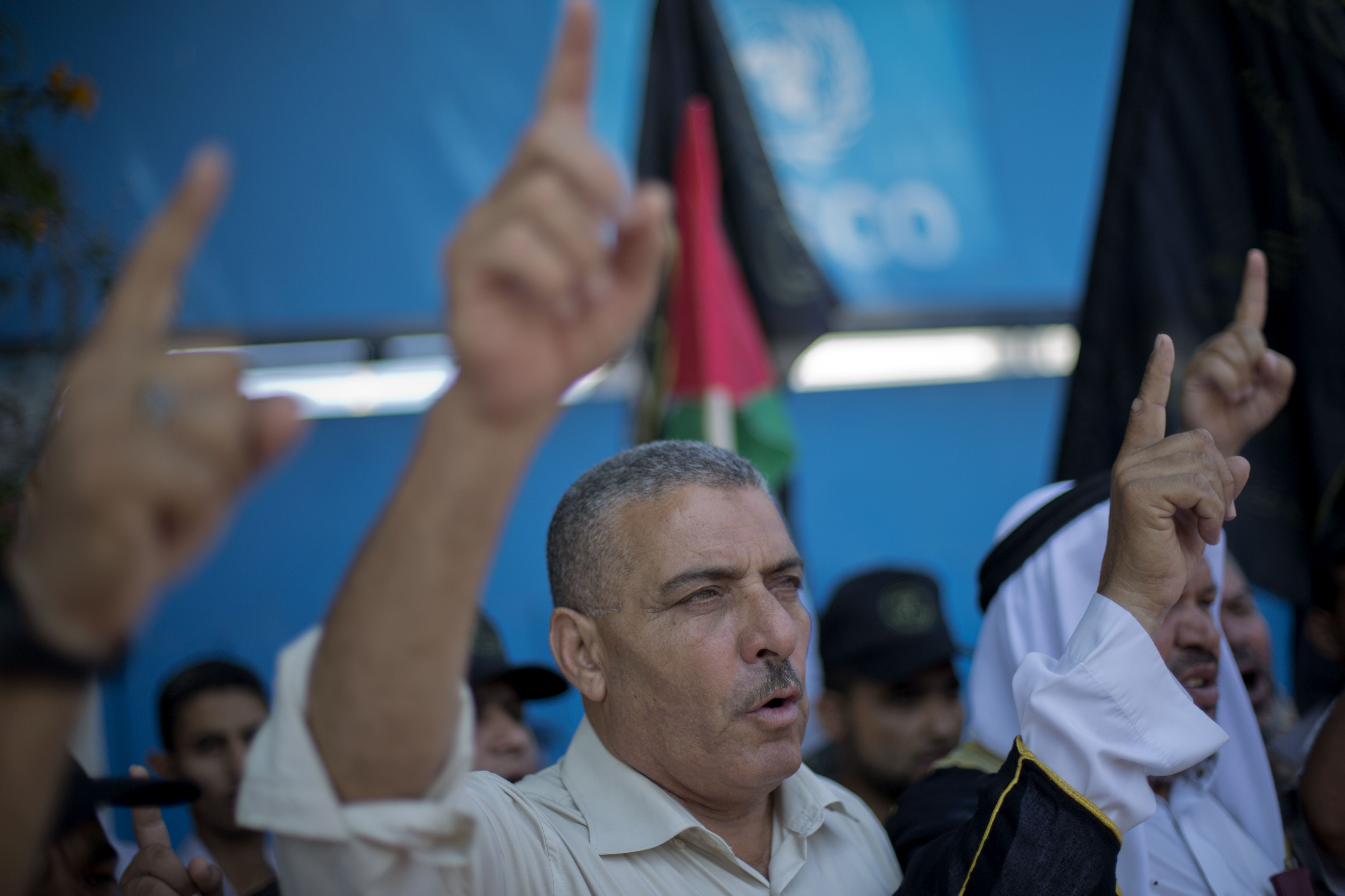 Palestinian protestors shout slogans next to the UNESCO headquarters in Gaza City during a demonstration against the Israeli government's plans to relocate Bedouins in the Negev desert, on July 17, 2013.  (AFP Photo)