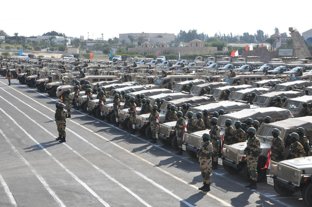 Military officers stand next to US-made Humveesin 2014.  (Photo from Armed Forces)