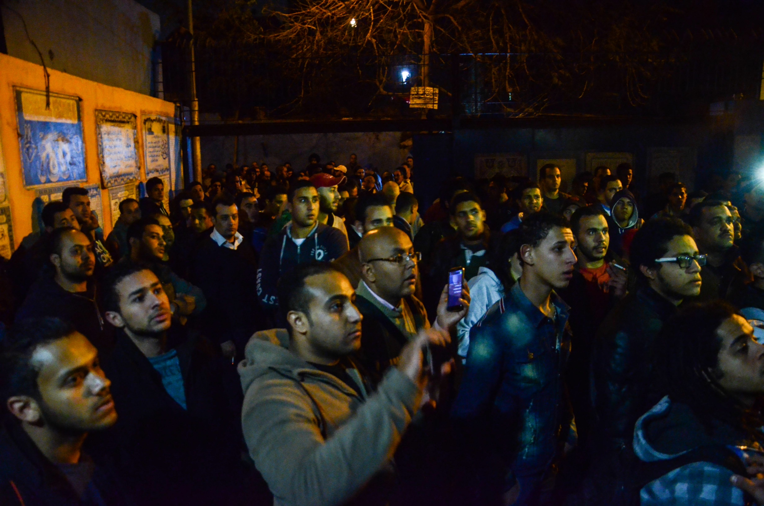 Football Fans and families of killed supporters in front of Zeinhom morgue in Cairo waiting to receive bodies of dead Zamalek fans killed during a violent dispersal by security forces of crowding fans on Sunday before a match between Zamalek and ENPPI (Photo by Mahmoud Abu El-Dahab)
