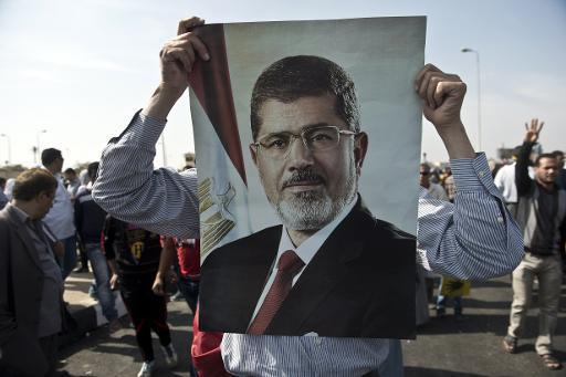 A supporter of ousted president Mohamed Morsi holds his poster during a rally in Cairo on November 4, 2013 (AFP File Photo)