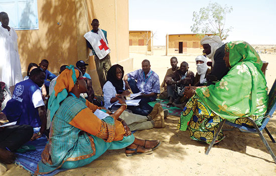 Representatives from the Office for the Coordination of Humanitarian Affairs (OCHA), United Nations agencies and partners meet with a village chief in Sinegodar, Niger (Photo from OCHA/Nicole Lawrence)