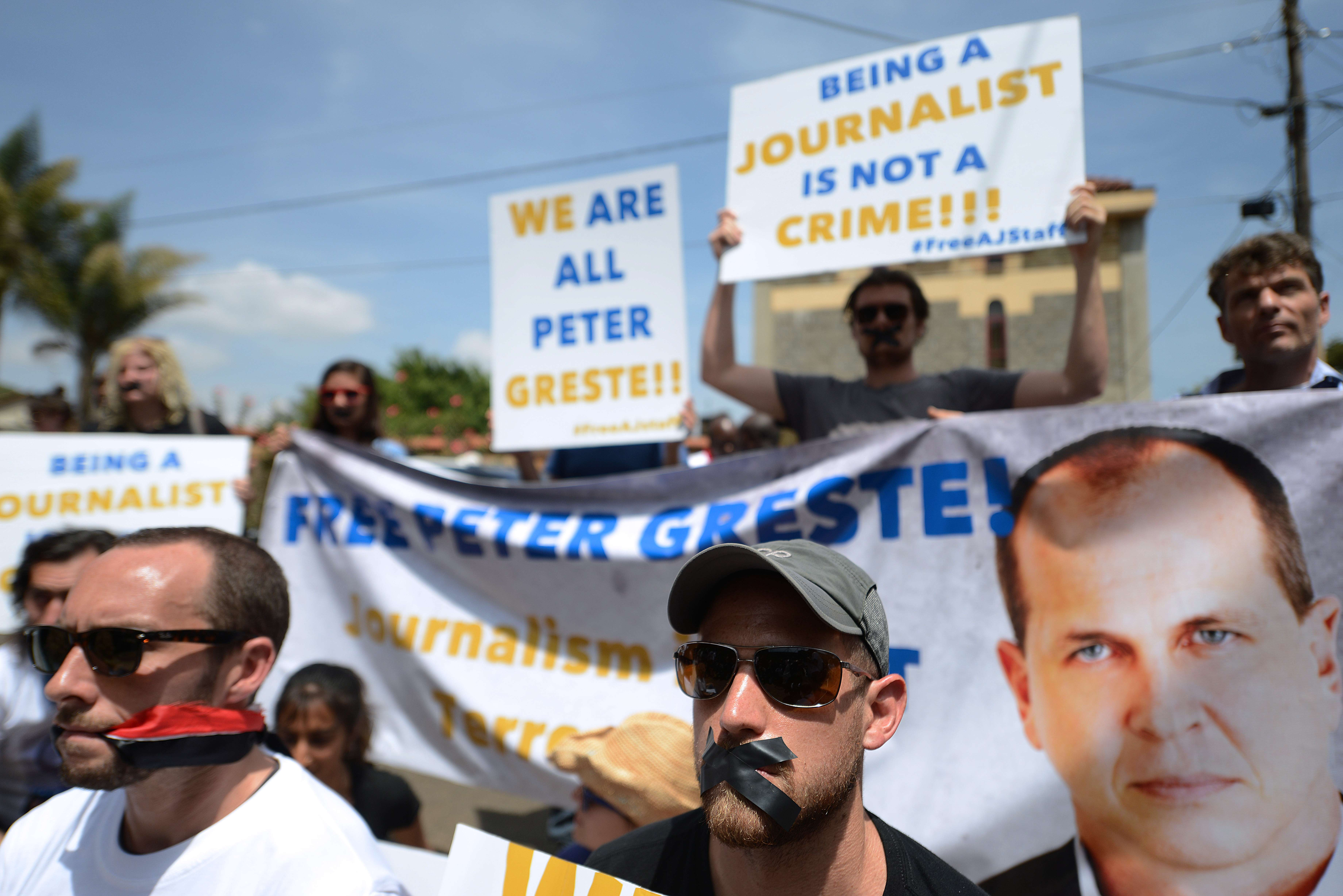 Journalists demonstrate in Nairobi for the release of Al Jazeera journalists in Egypt, as they march to the Egyptian Embassy in Nairobi, on 4 February  (AFP PHOTO/SIMON MAINA)